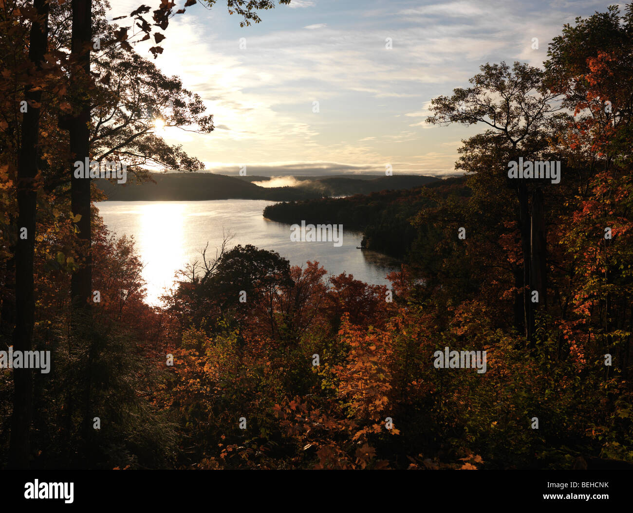 Beautiful fall nature scenery framed with colorful trees at dawn ...
