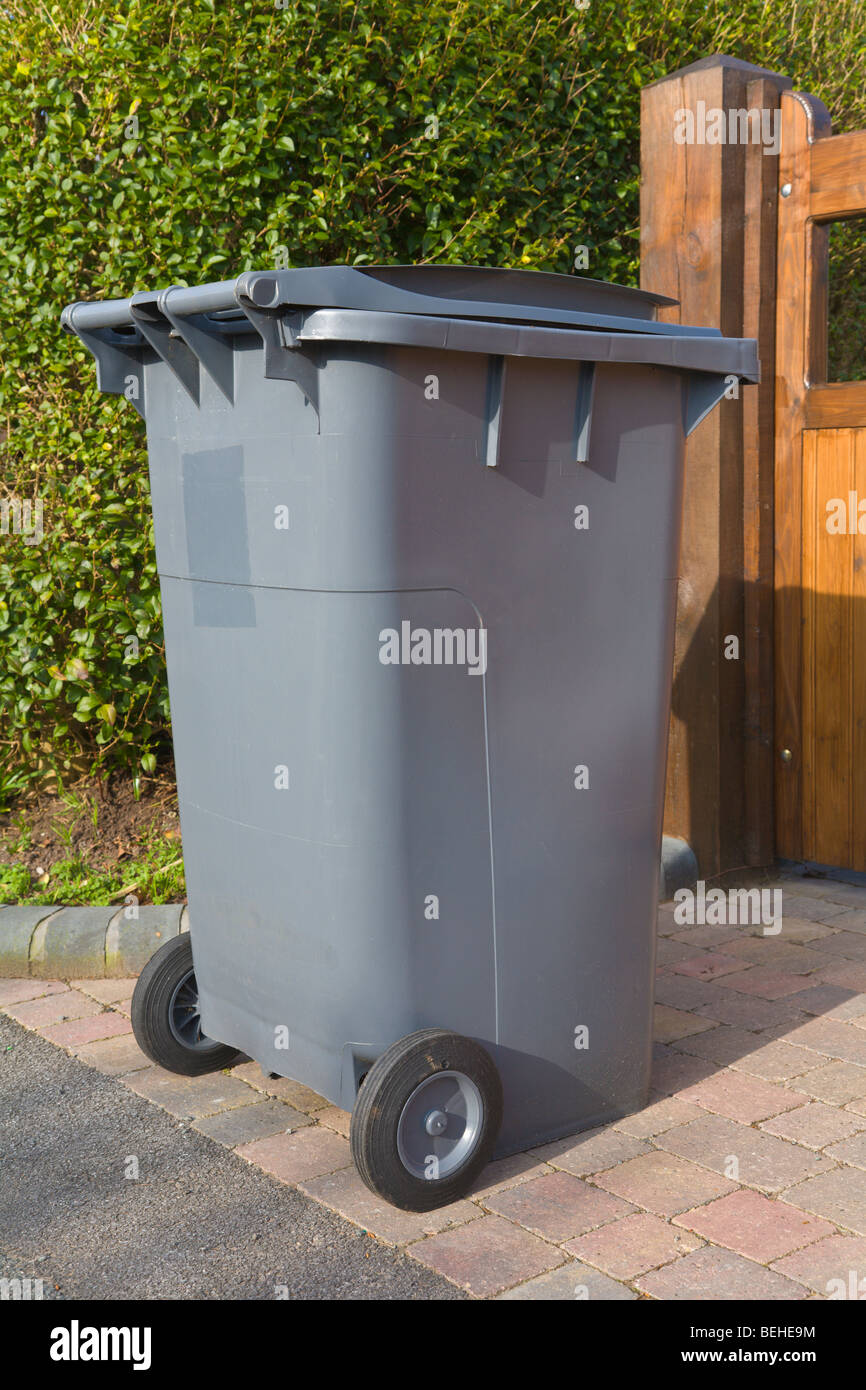 Wheelie bin outside house waiting for refuse collection - Stock Image