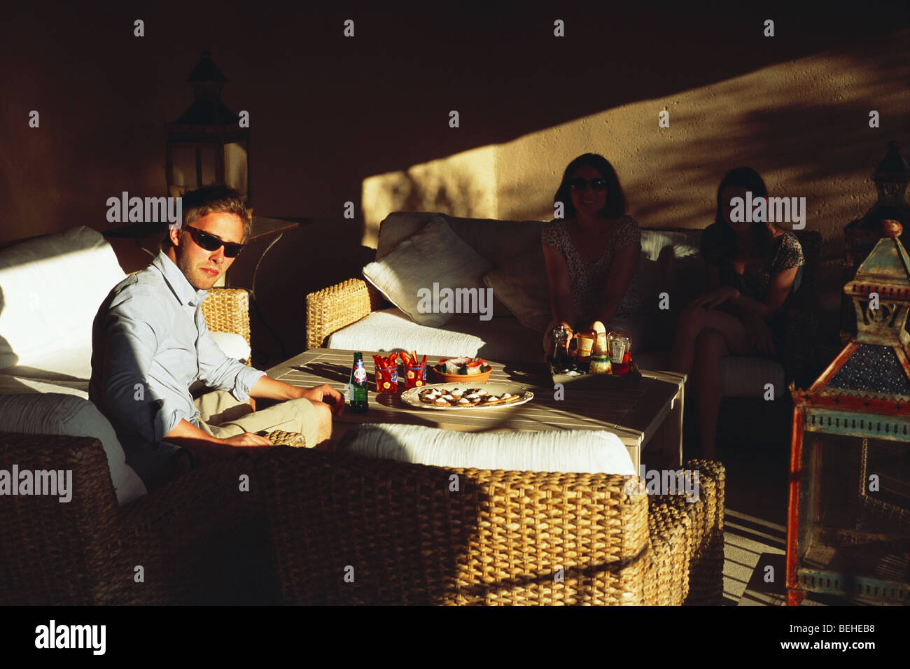 Young Englishman on holiday enjoys meal outside in garden room Provence France - Stock Image