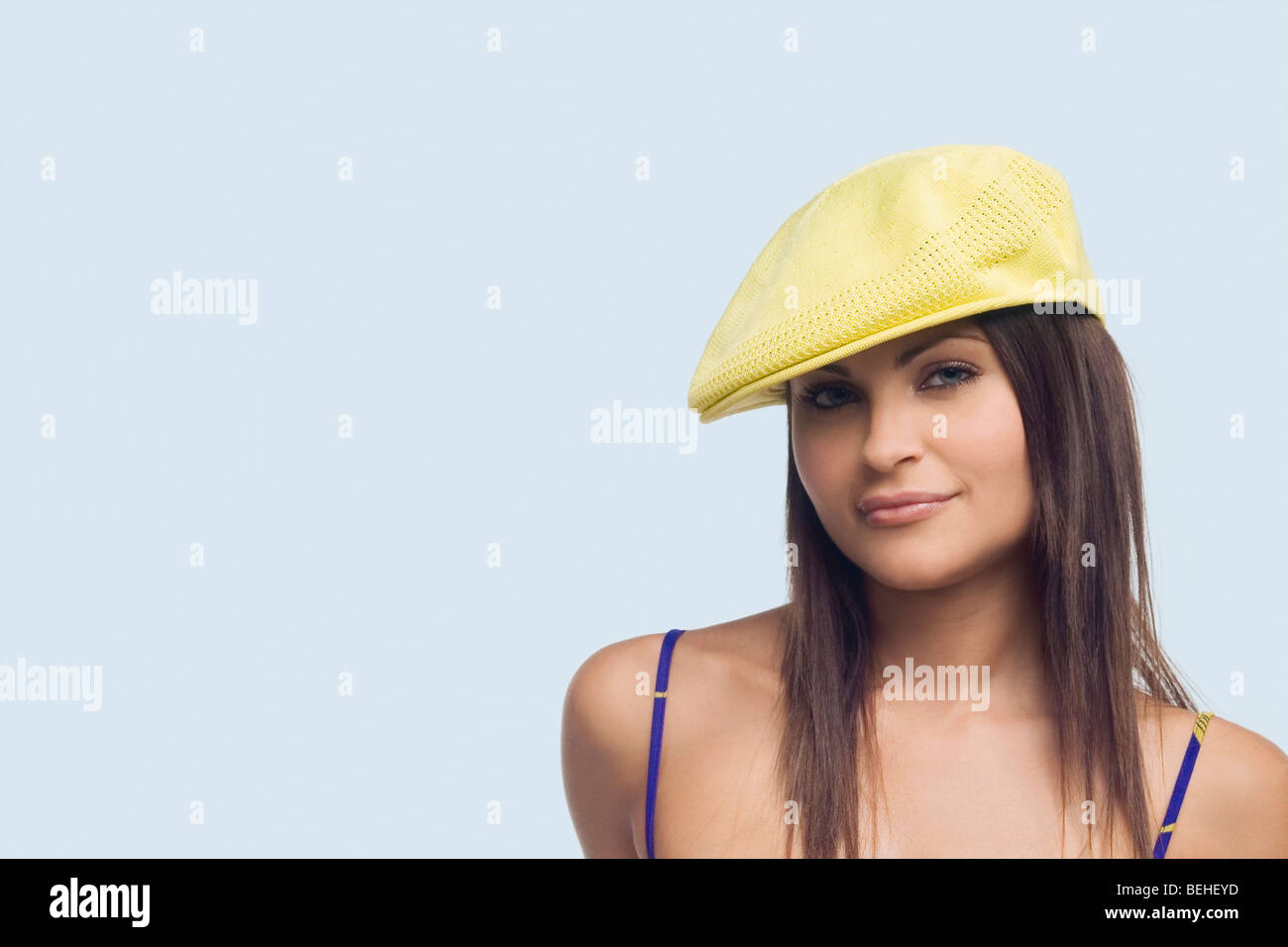 f0aa69b87af00 Portrait of a young woman wearing a flat cap and smirking Stock ...