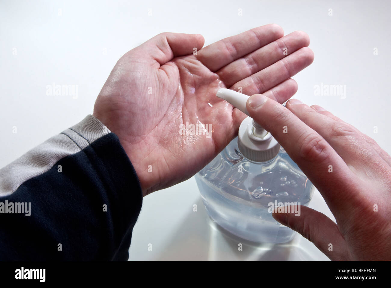 Cleaning hands with antibacterial gel - Stock Image