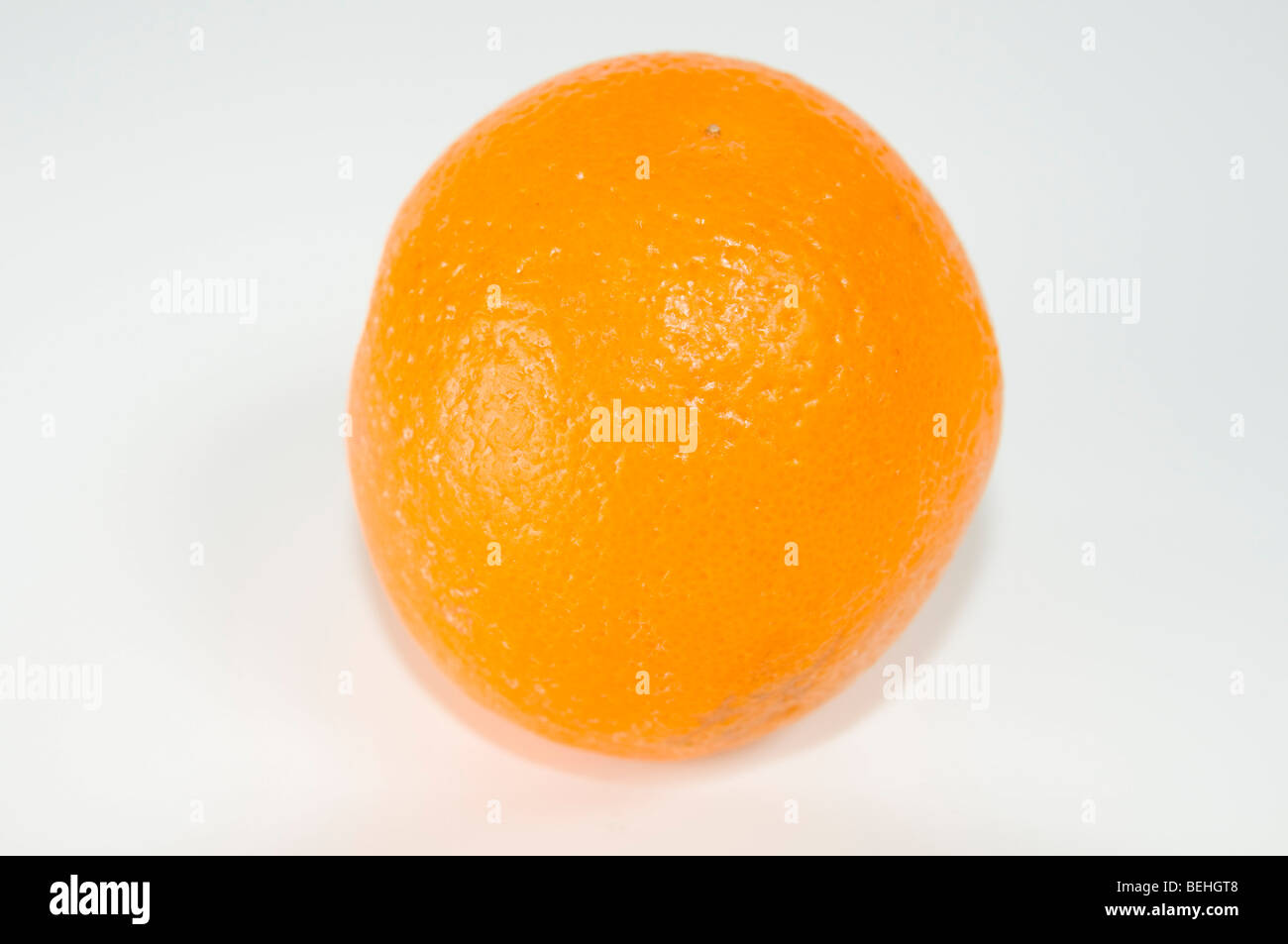 Cutout of an Orange on white background - Stock Image