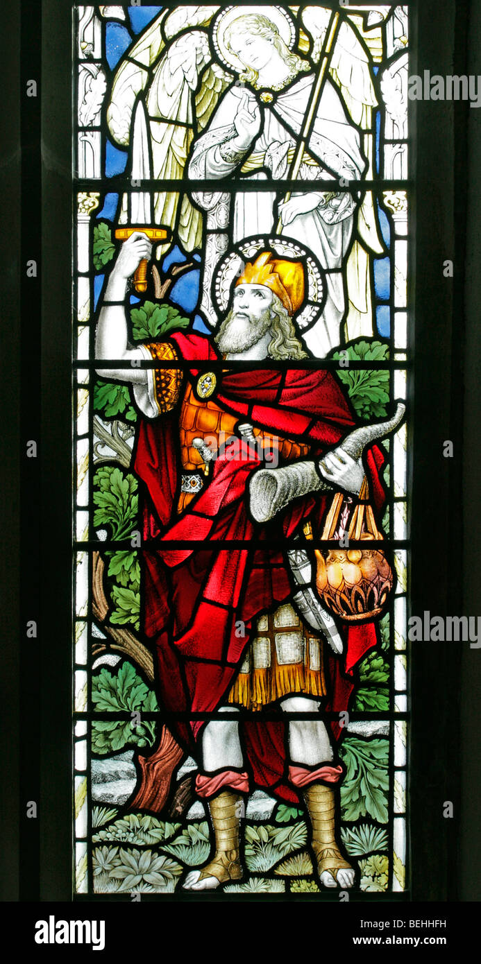 A stained glass window depicting Gideon holding a sword and ram's horn, All Saints Church, Warham, Norfolk Stock Photo