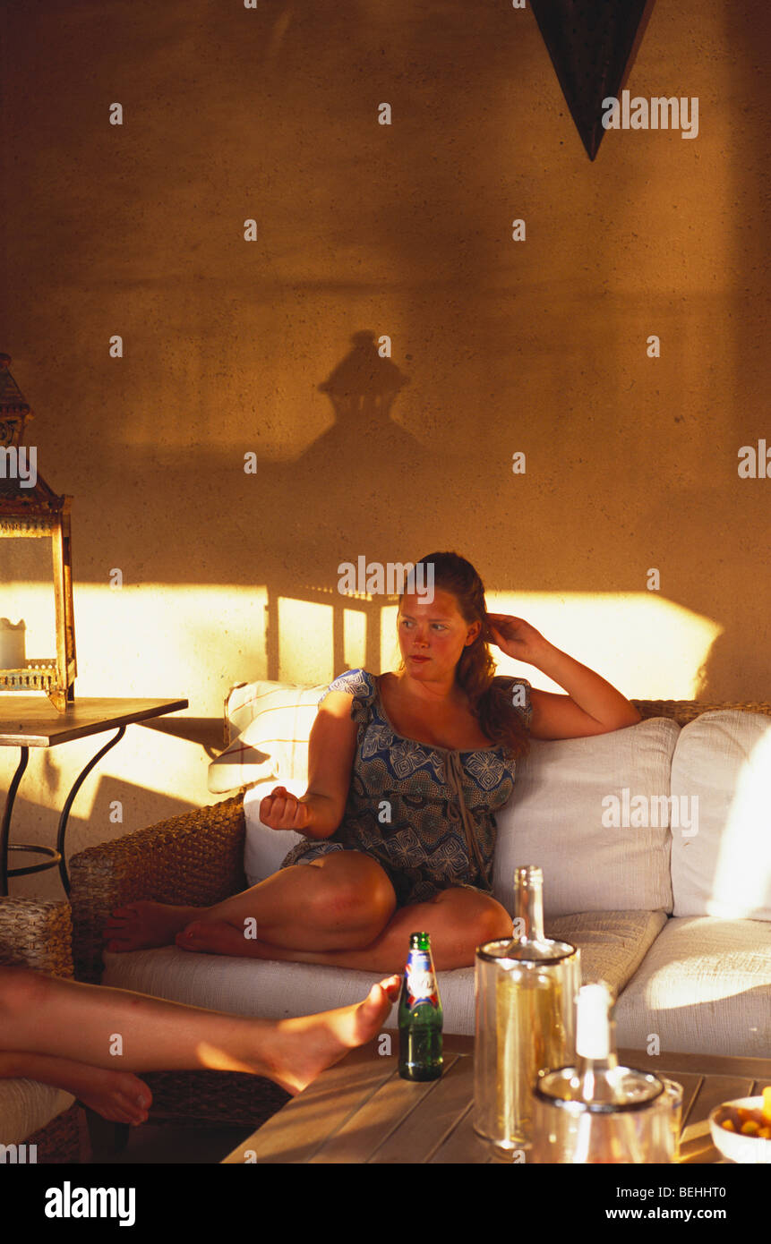 Young Englishwoman on holiday enjoys meal outside in garden room Provence France - Stock Image