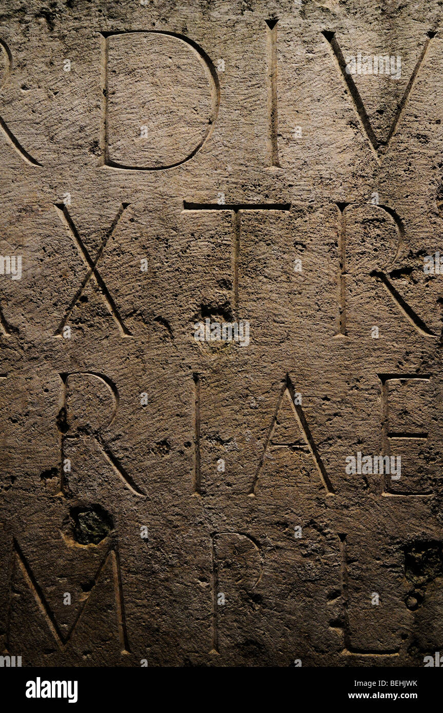Inscriptional capitals and traditional roman typography. Colosseum, Rome, Italy. - Stock Image