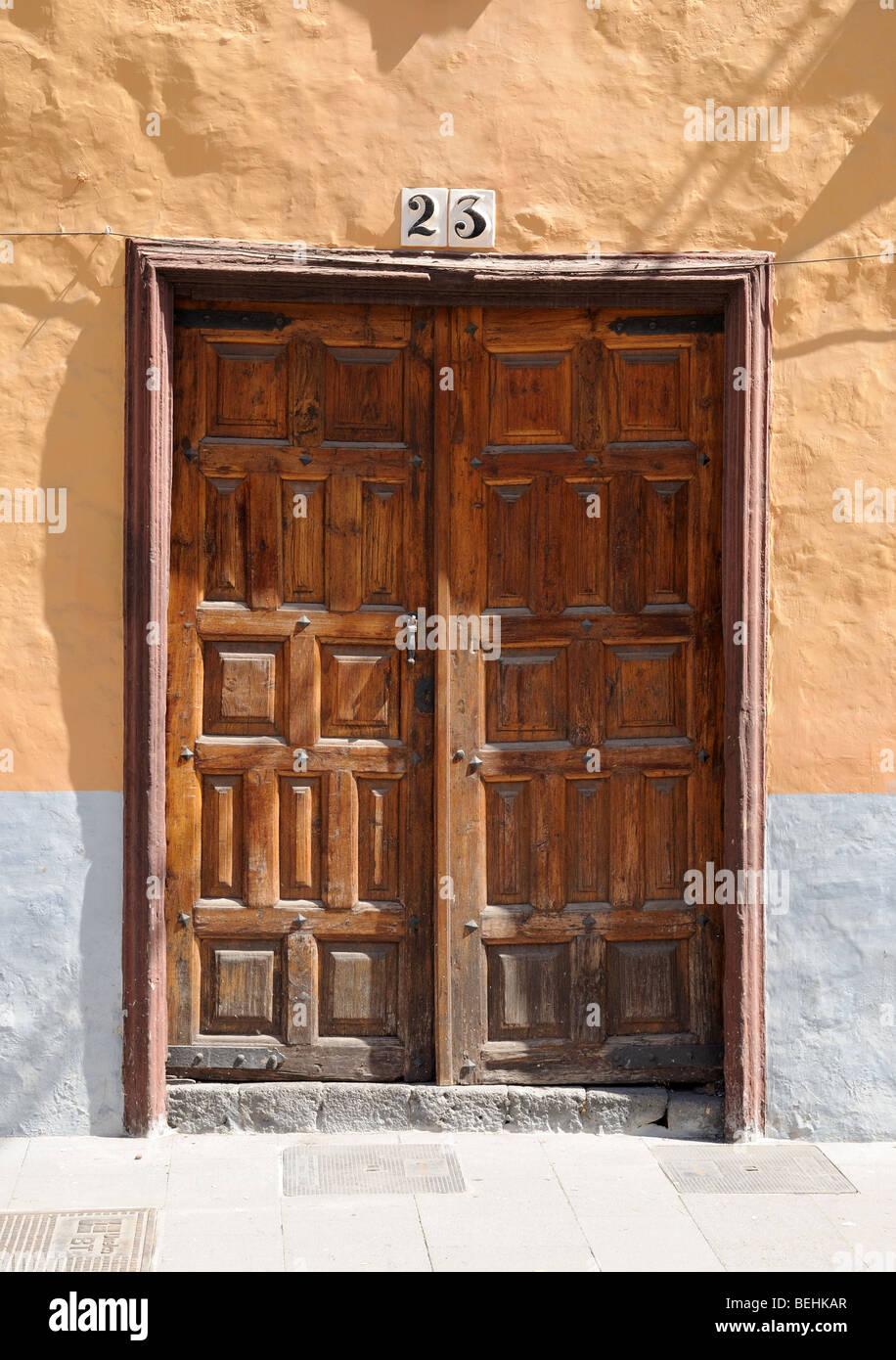 Old wooden door with number 23. Tenerife Spain - Stock Image