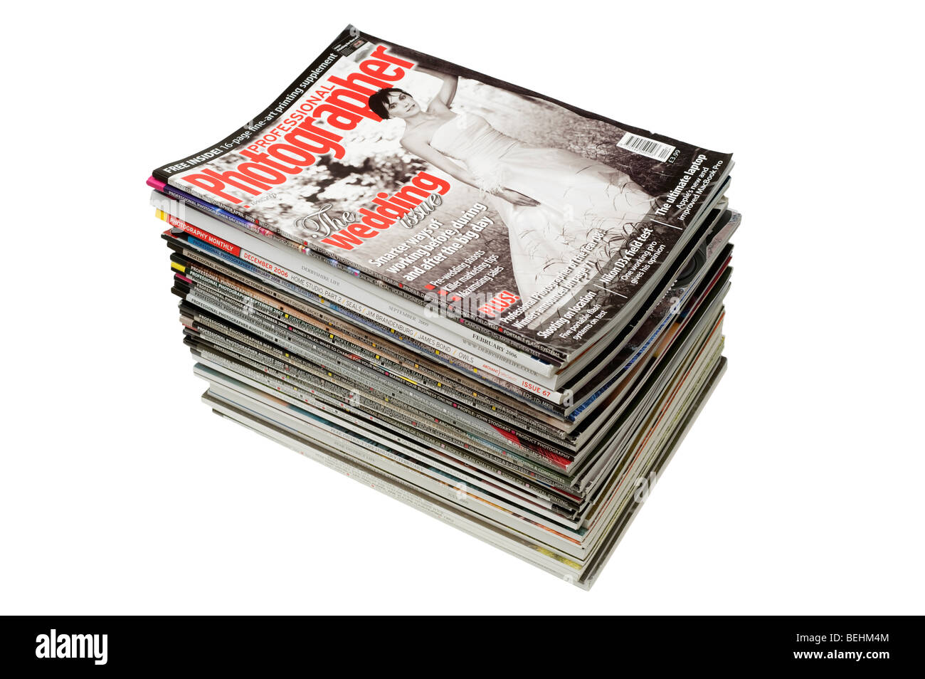 A neat pile of colourful magazines - Stock Image