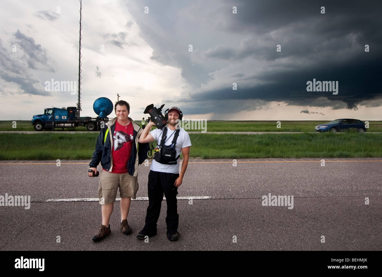 Two storm chasing videographers pose in front of a storm in Goshen County, Wyoming, USA, June 5, 2009 during Project - Stock Image