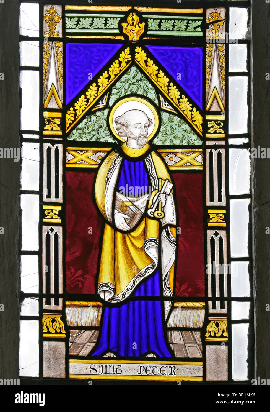 A stained glass window depicting St Peter the Apostle holding the keys to Heaven, All Saints Church, Wighton, Norfolk - Stock Image