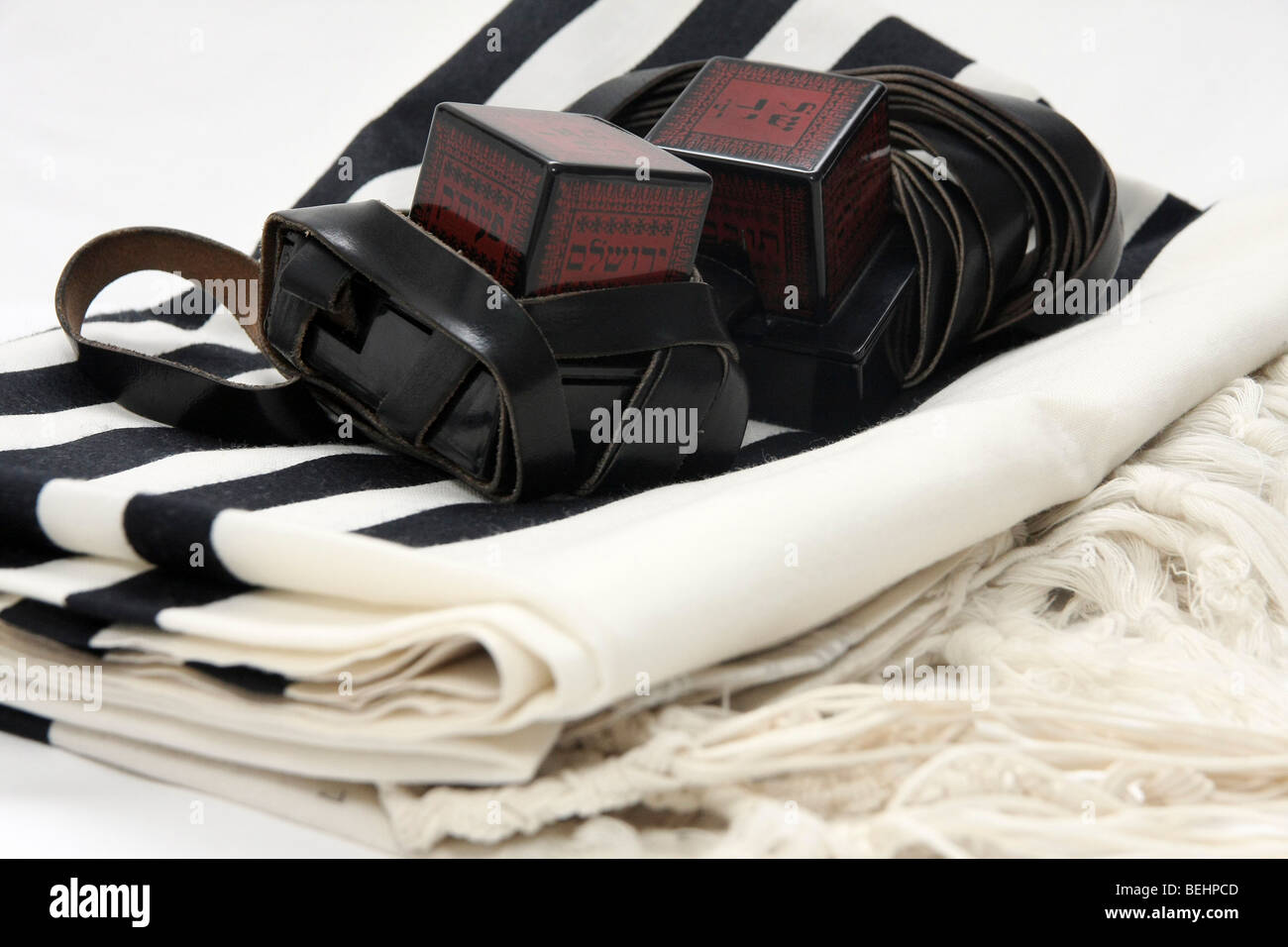 Cutout of Tifillin and Talit on white background - Stock Image