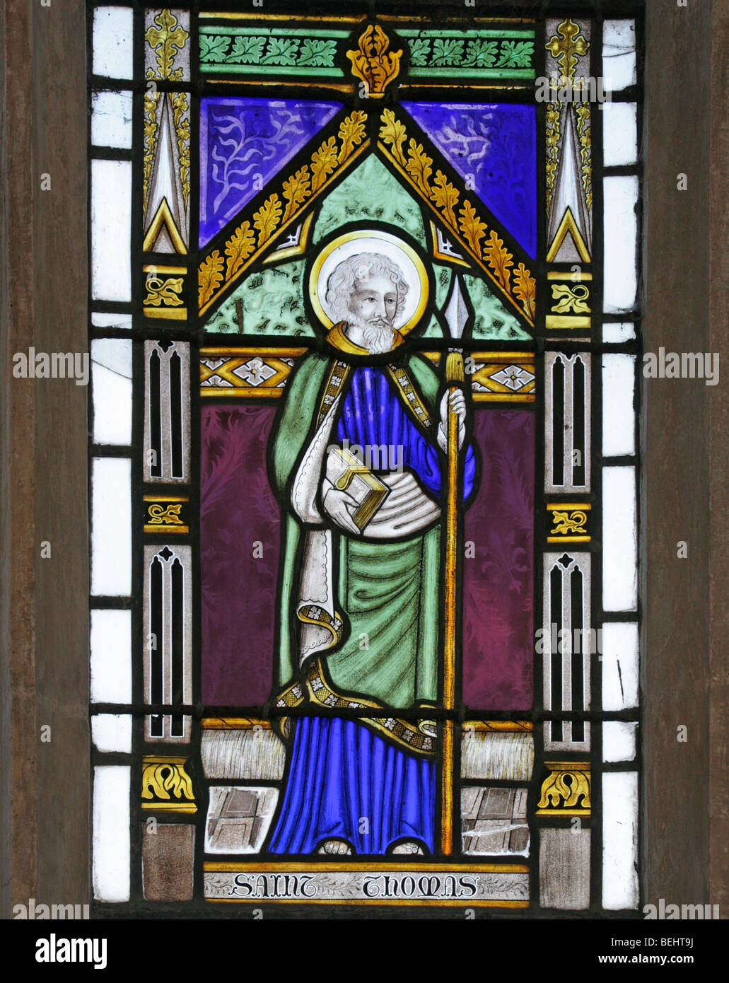 A stained glass window depicting St Thomas the Apostle, All Saints Church, Wighton, Norfolk by Joseph Grant of Costessey - Stock Image