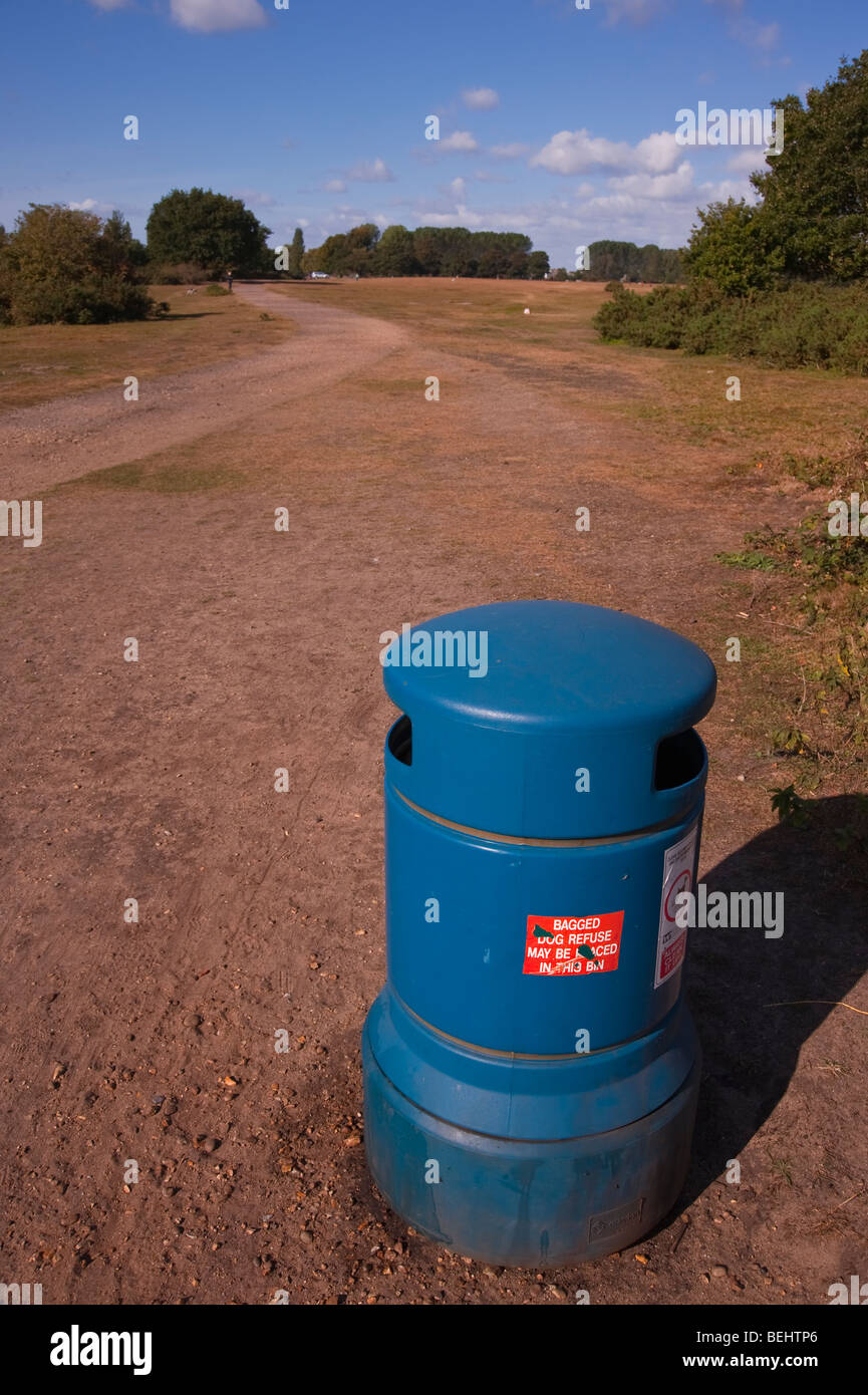A bin for depositing dogs mess at the common in Beccles , suffolk , Uk - Stock Image