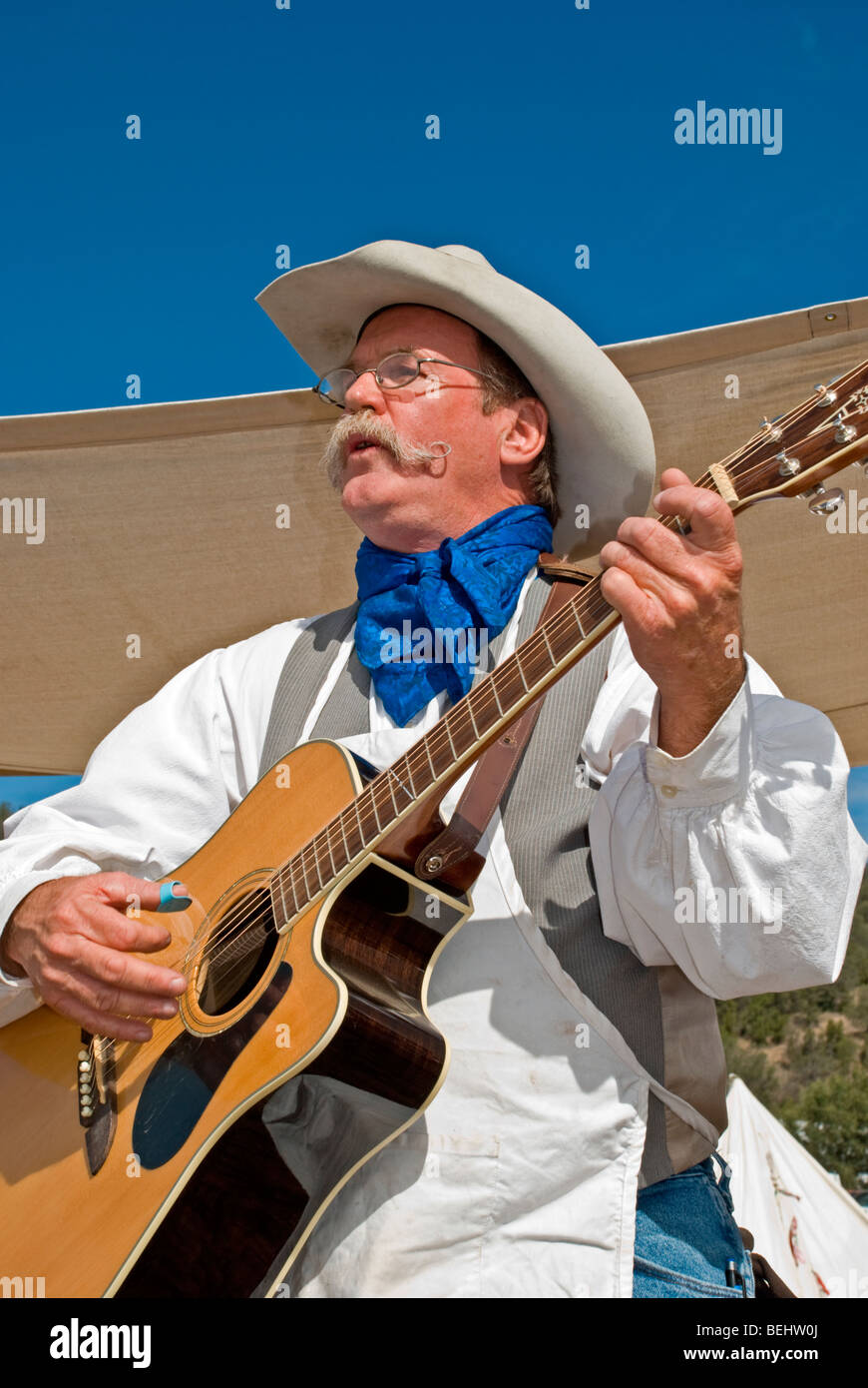 A country-western singer plays popular old western tunes ...