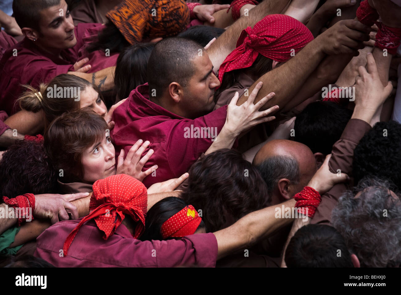 Castellers forming a human pyramid during festival in Bellver Castle Palma Mallorca Spain - Stock Image