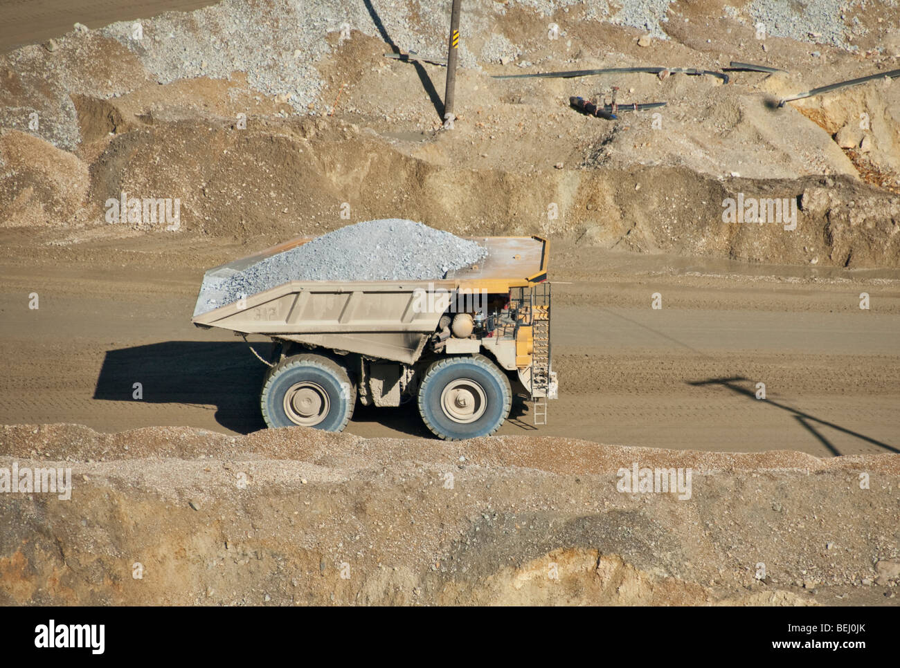 Utah Kennecott Utah Copper Bingham Canyon Mine world's largest man-made excavation haultruck load capacity 320 - Stock Image