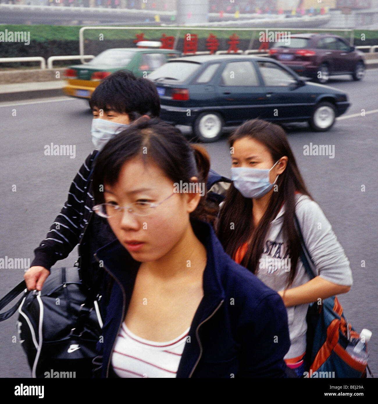 Young couple wear masks to protect against severe pollution in Beijing, China. 30-Sep-2009 - Stock Image