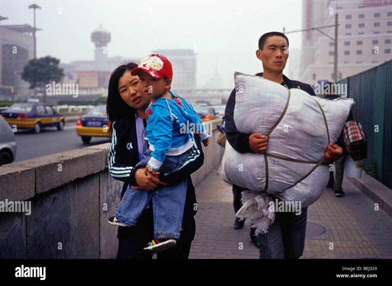Migrant worker on their way to the train station in Beijing, China. 30-Sep-2009 - Stock Image
