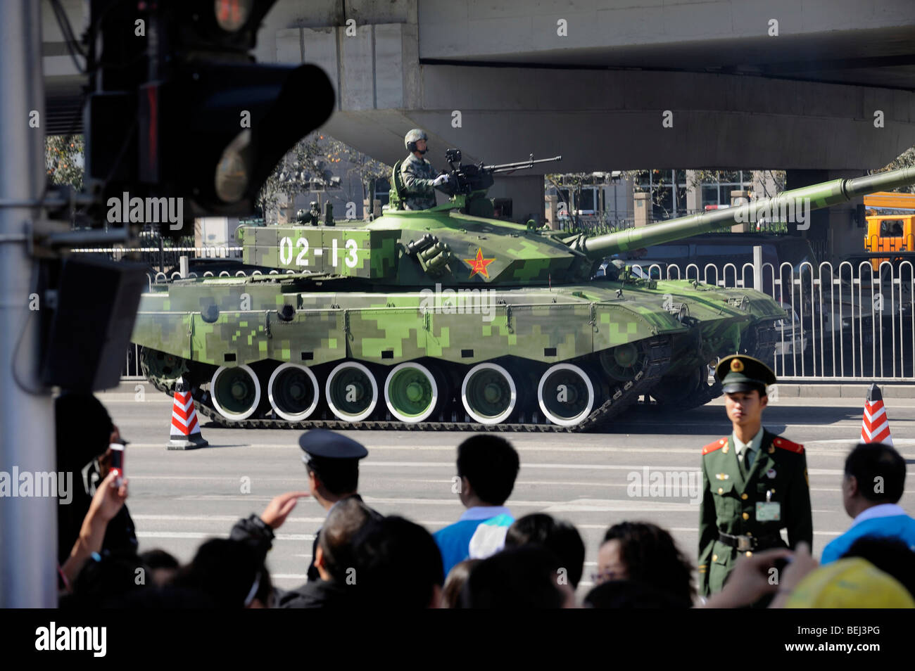 Military tanks, 99A leave the parade marking China's 60th anniversary of the People's Republic of China. - Stock Image