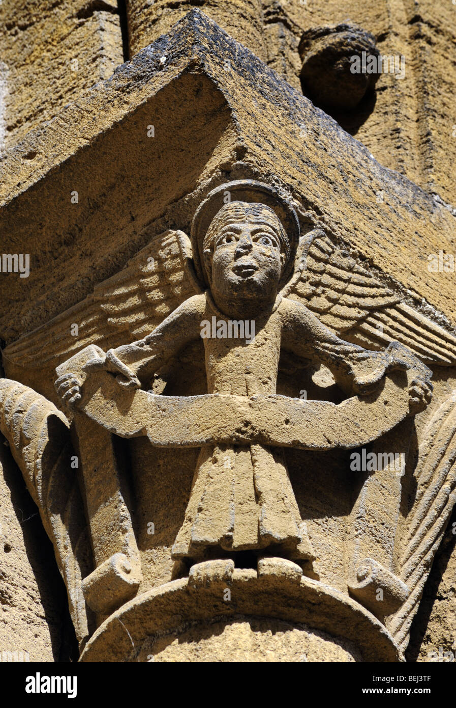 Carvings on the Church in the historic hillside village of Conques, France - Stock Image