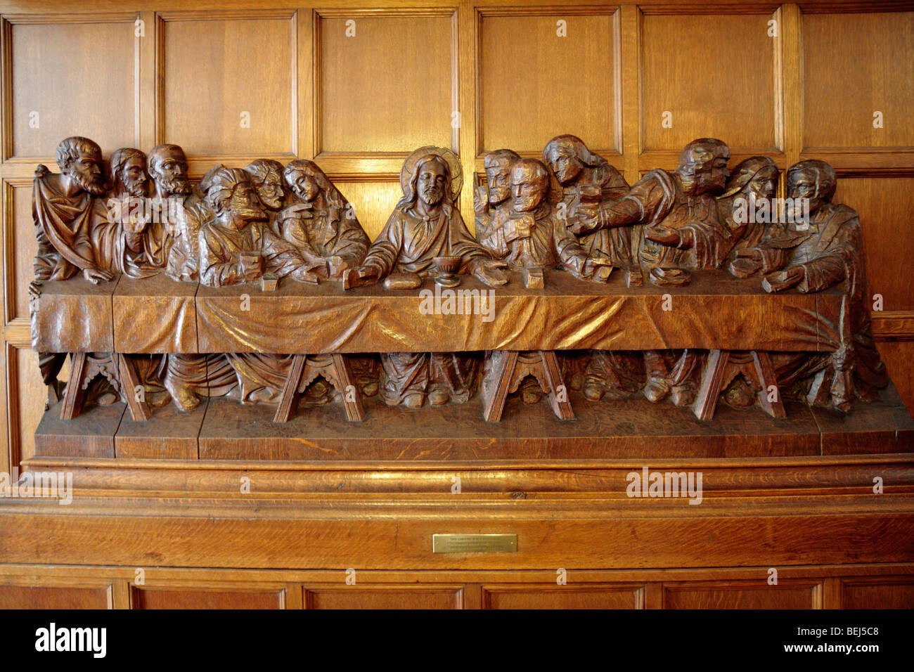 A large wooden carving of jesus and the last supper on display at
