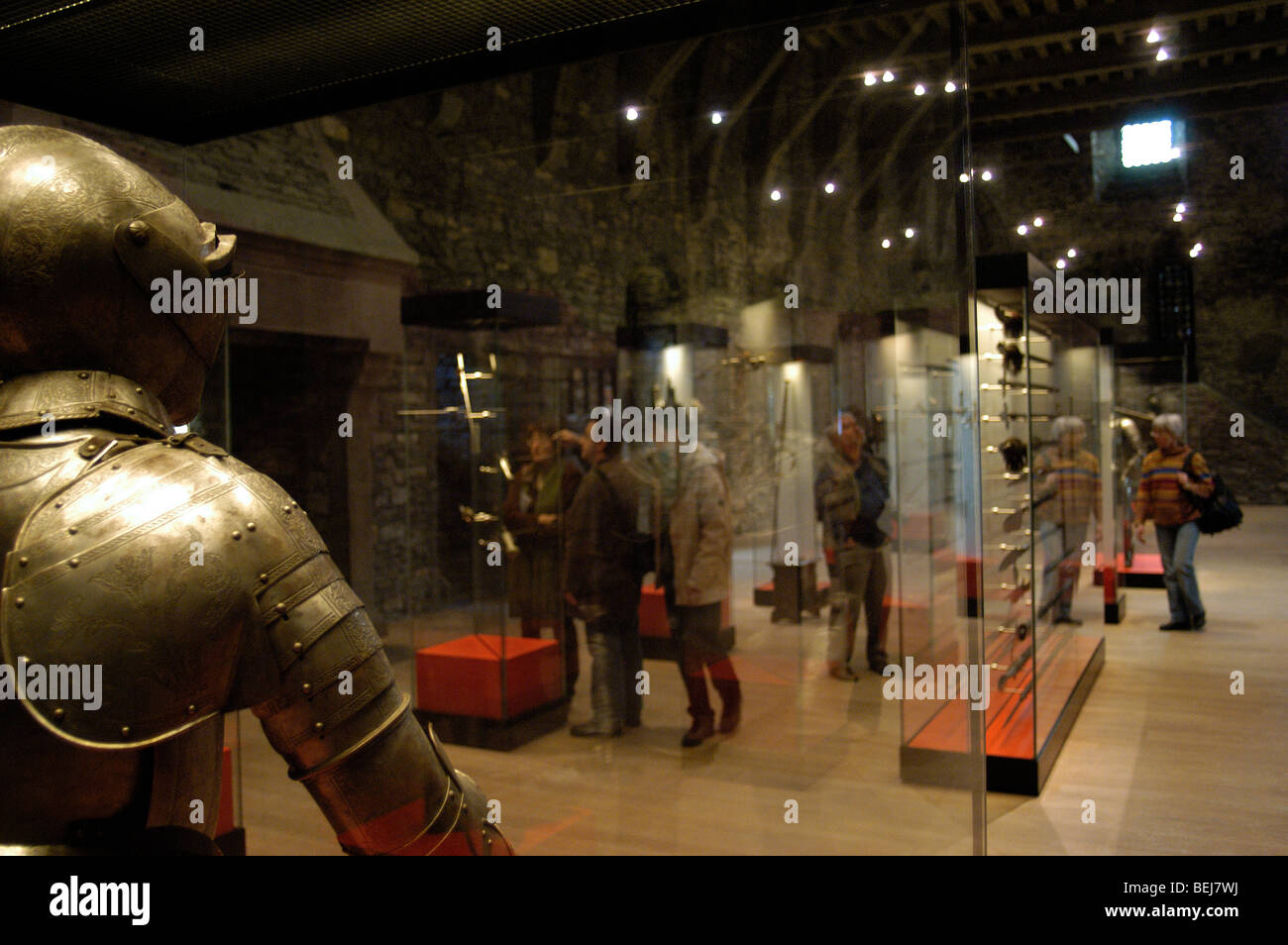 Tourists visiting the mediaeval armoury at the Gravensteen / Castle of the Counts in Ghent, Belgium - Stock Image