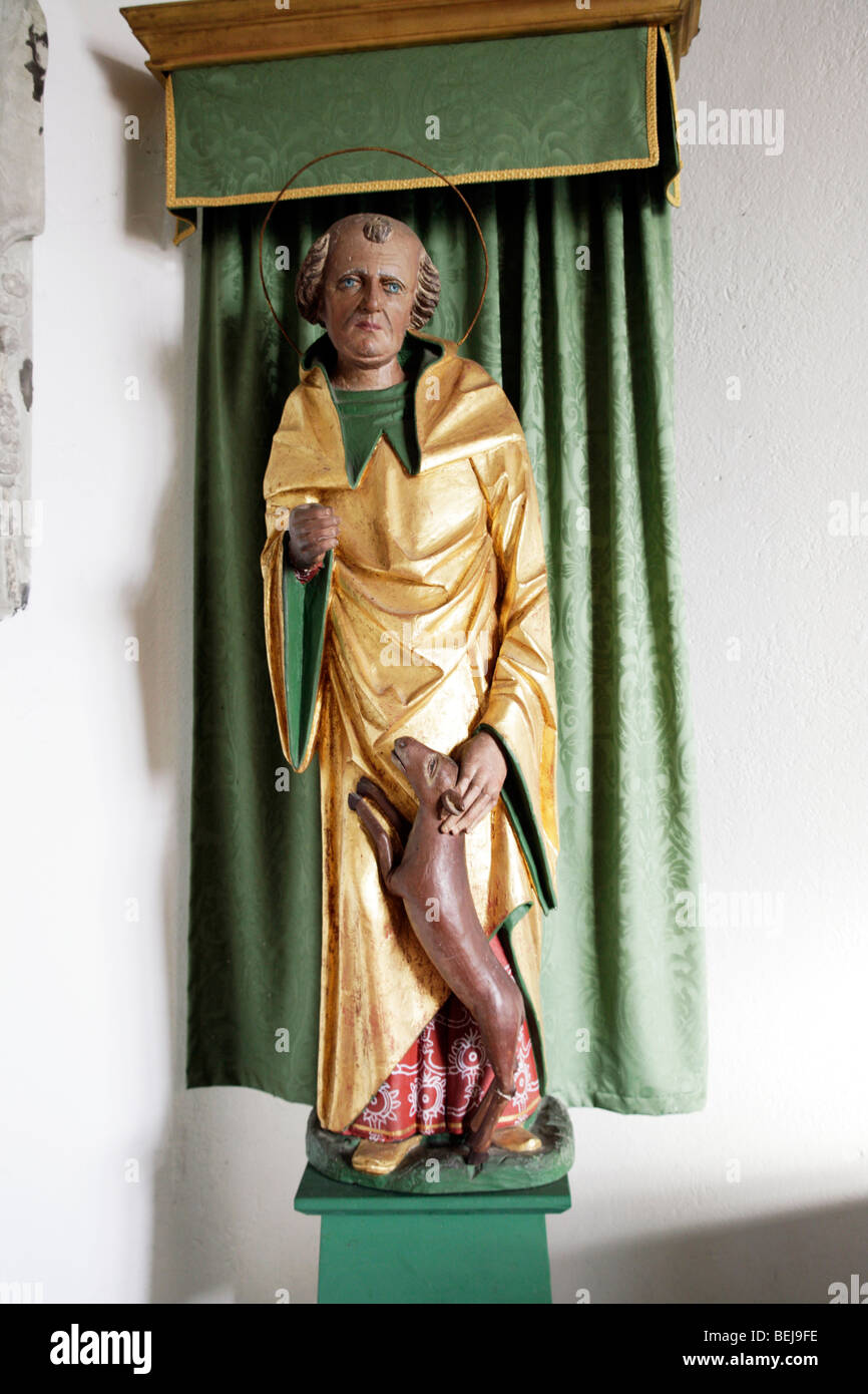 A painted statue depicting Saint Giles, St Giles Church, Houghton St Giles, Norfolk - Stock Image