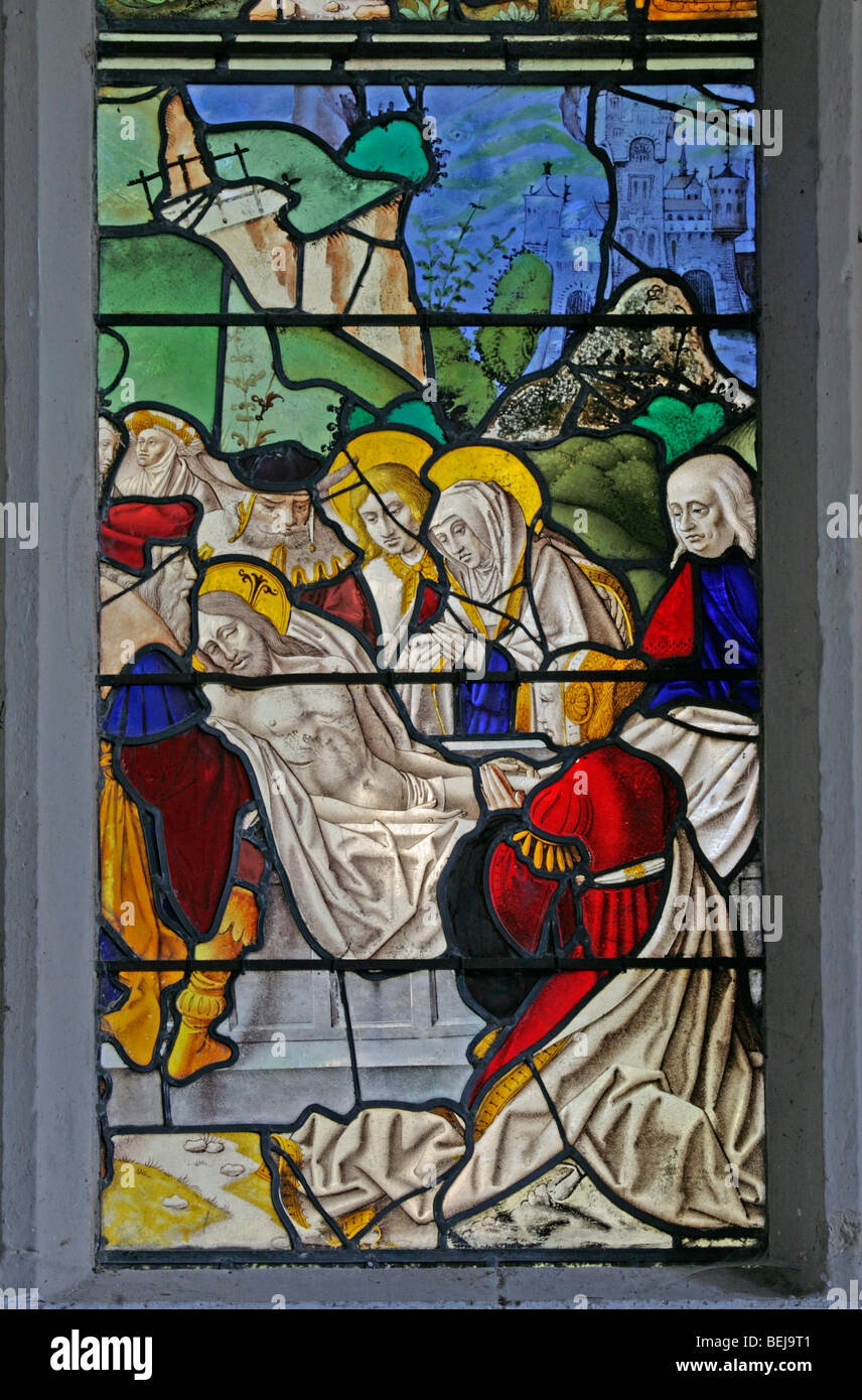 Detail of the medieval stained glass window depicting the entombment of Jesus Christ, St Mary Magdalene Church, - Stock Image