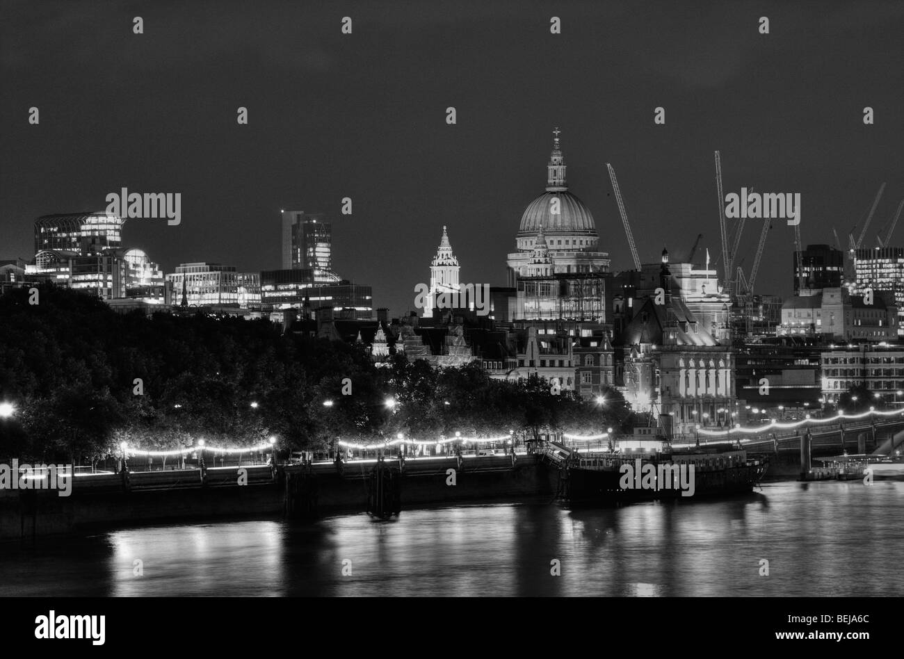 St Paul's Cathedral and the City of London seen from across the River Thames at night. - Stock Image