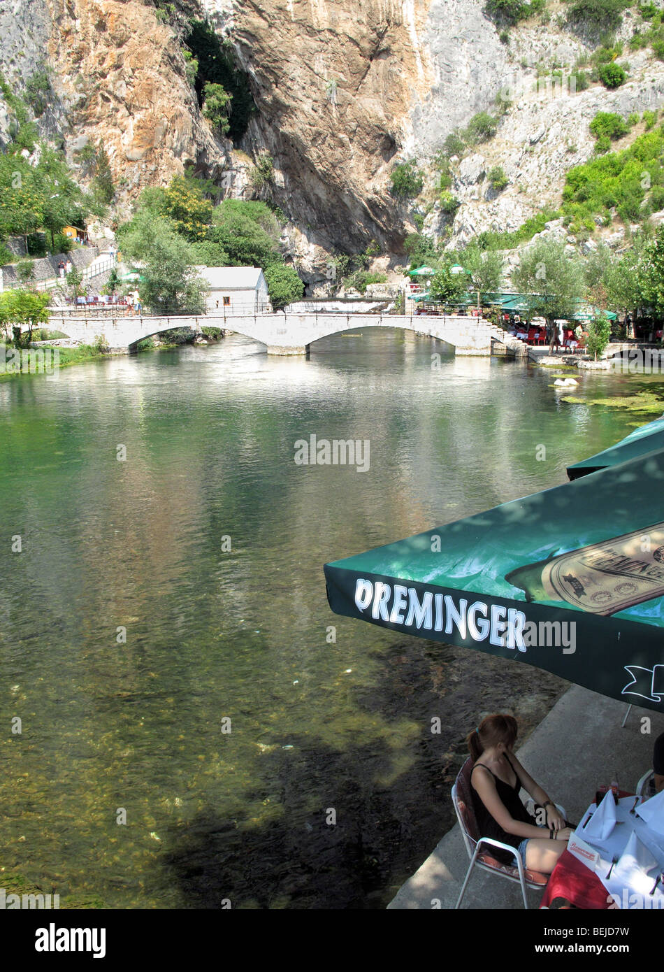 Bosnia and Herzegovina, Blagaj, outing spot with Open air restauranst on the banks of Buna rive - Stock Image