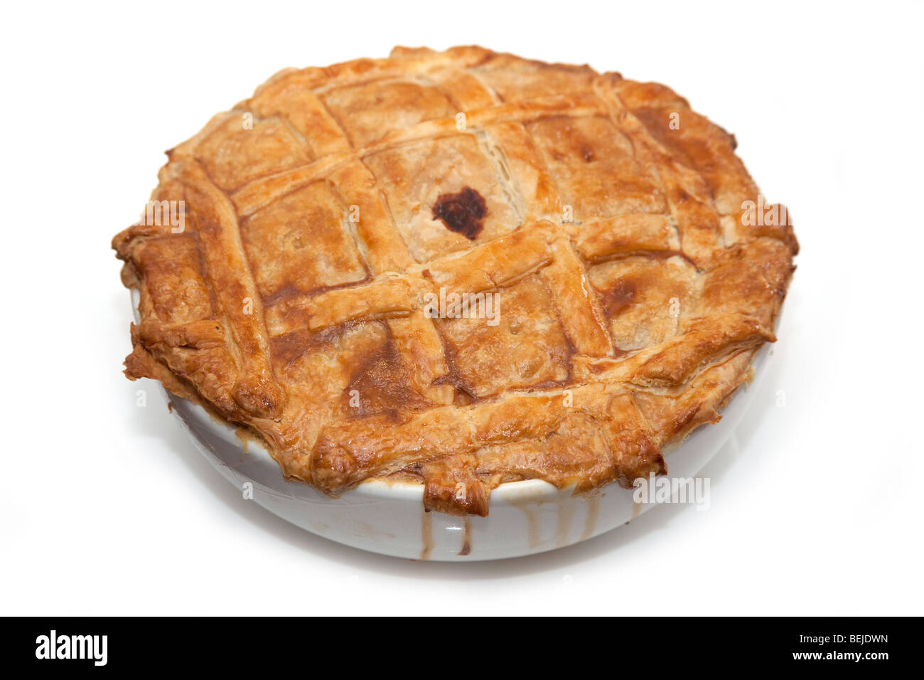 Steak and kidney pie isolated on a white studio background. - Stock Image