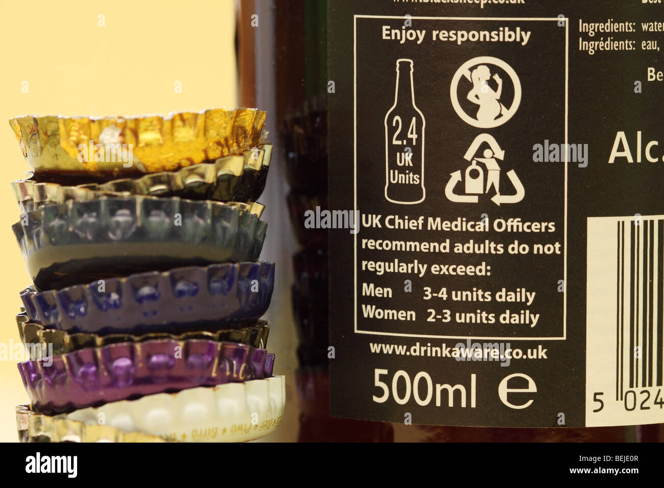 Drinkaware alcohol consumption health warning notice on beer bottle in UK encouraging responsible drinking - Stock Image