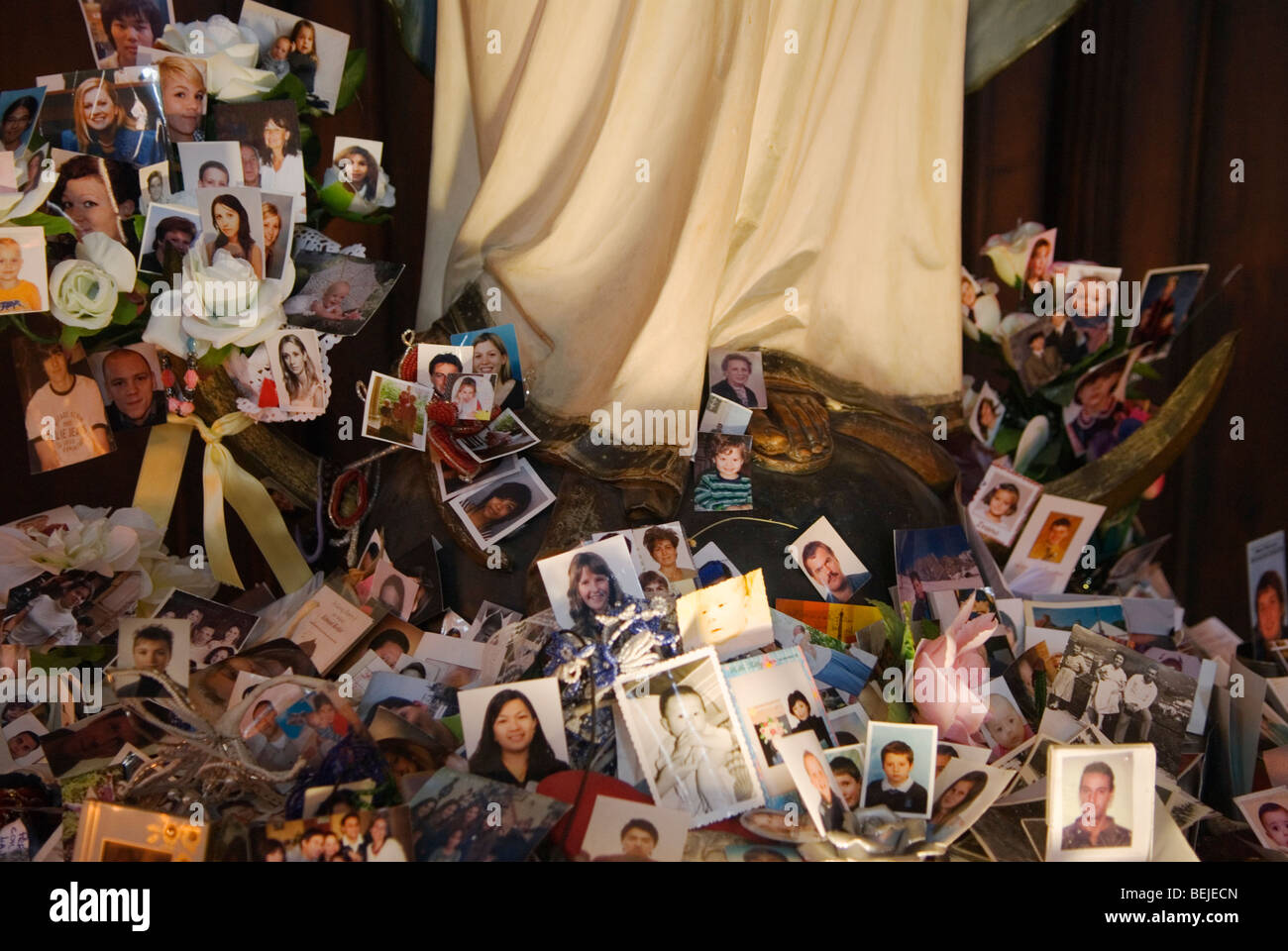 Santa Maria Gloriosa dei Frari Venice Italy. Photographs of ill and unwell people left at the base of a statue of - Stock Image