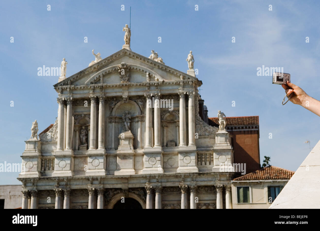 Venice Italy  Tourist takes photograph of church of San St Maria di Nazareth. HOMER SYKES - Stock Image