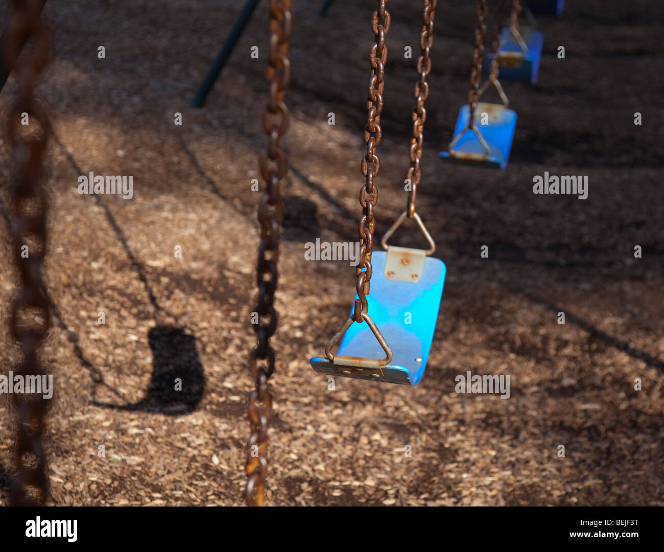 Swings in a row - Stock Image