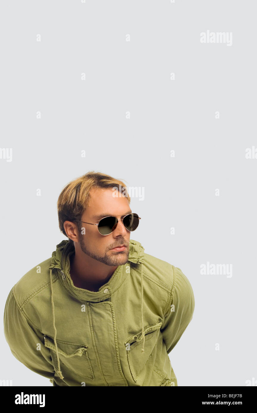 5c43d7b6f2cd Close-up of a mid adult man wearing sunglasses and bending forward ...