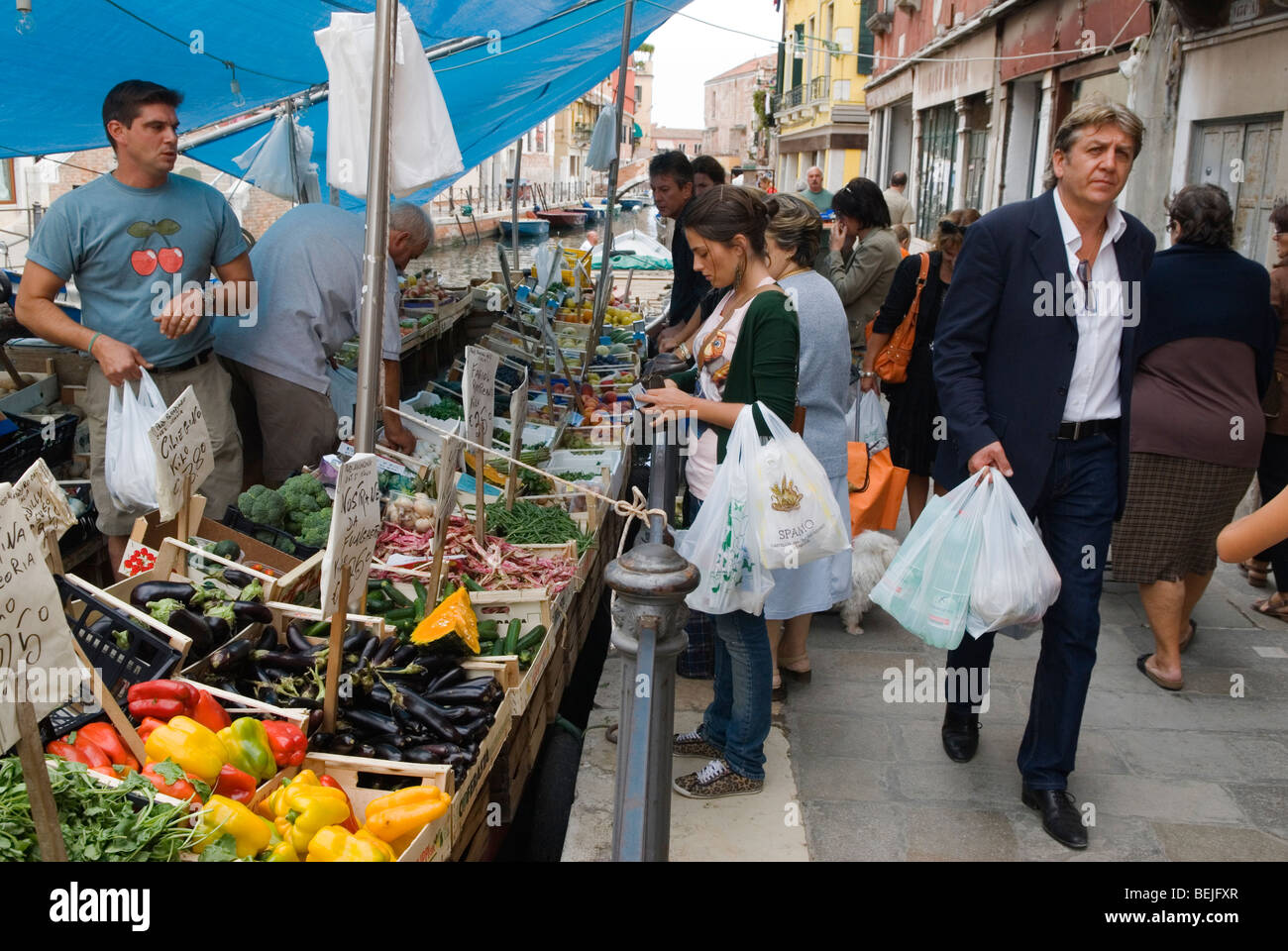Venice Italy People doing vegetable shopping on canal boat Arsenale Venice. HOMER SYKES - Stock Image