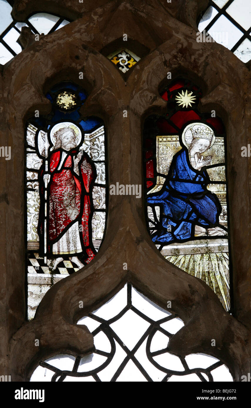 Detail of a medieval stained glass window depicting St Mathias the Apostle, left and one other, St Mary's Church, - Stock Image