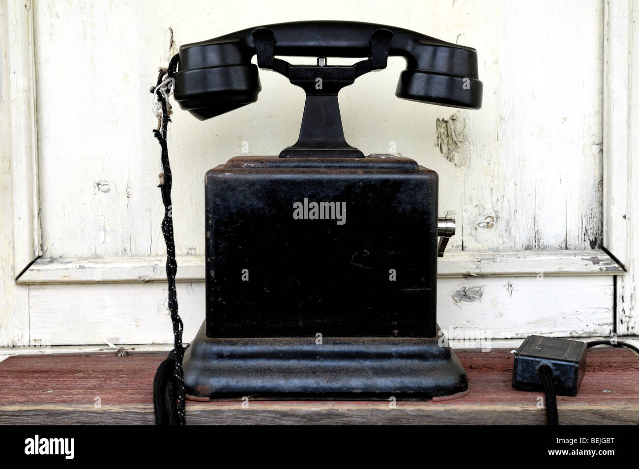 an old telephone in an old telephone booth. Stock Photo