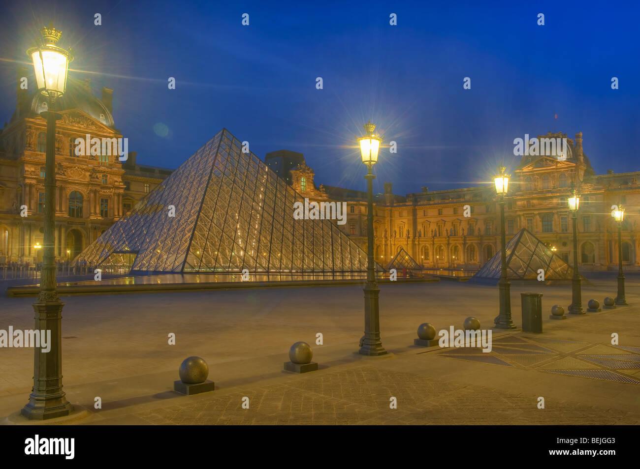 Louvre Pyramide at sunset, Paris, France - Stock Image