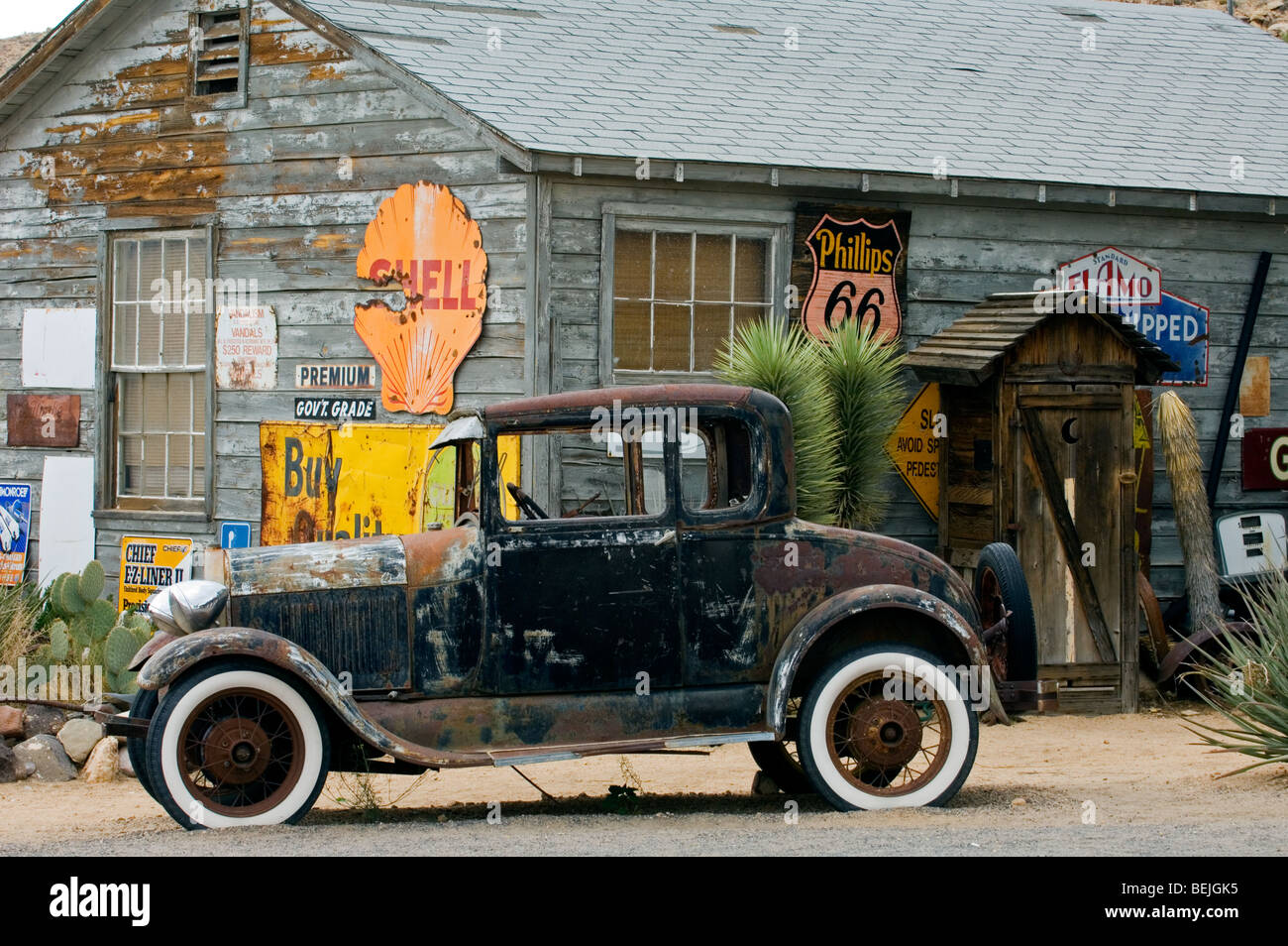 Old Ford vintage car along the Route 66 at the general store of the ghost town Hackberry in Arizona, USA - Stock Image