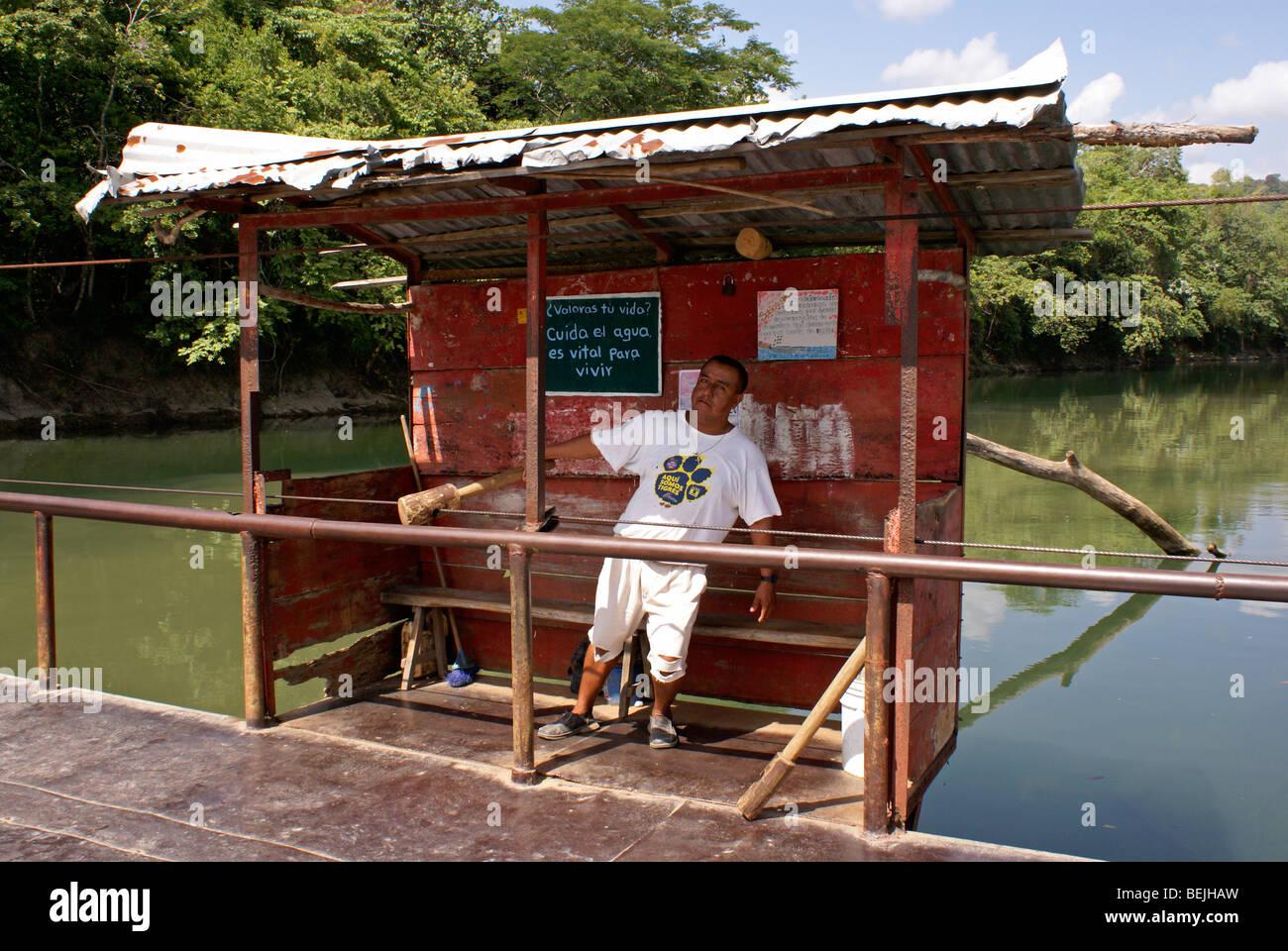 Hand operated river ferry operator near the town of Axtla de Terrazas, Huasteca region, San Luis Potosi state, Mexico - Stock Image