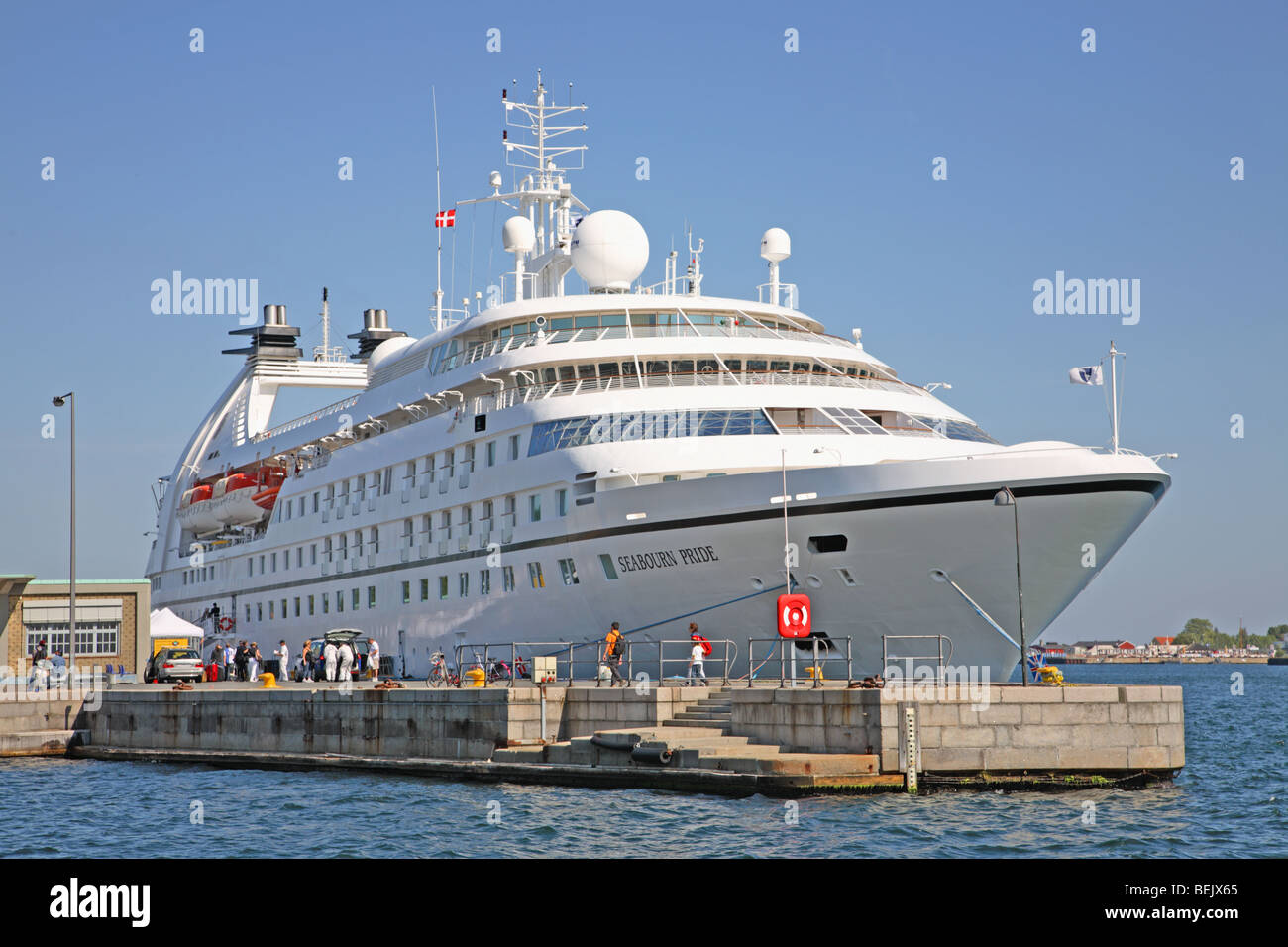 The cruise ship the MS Seabourn Pride calling at the Port of Copenhagen, Denmark, moored near the old custom house - Stock Image
