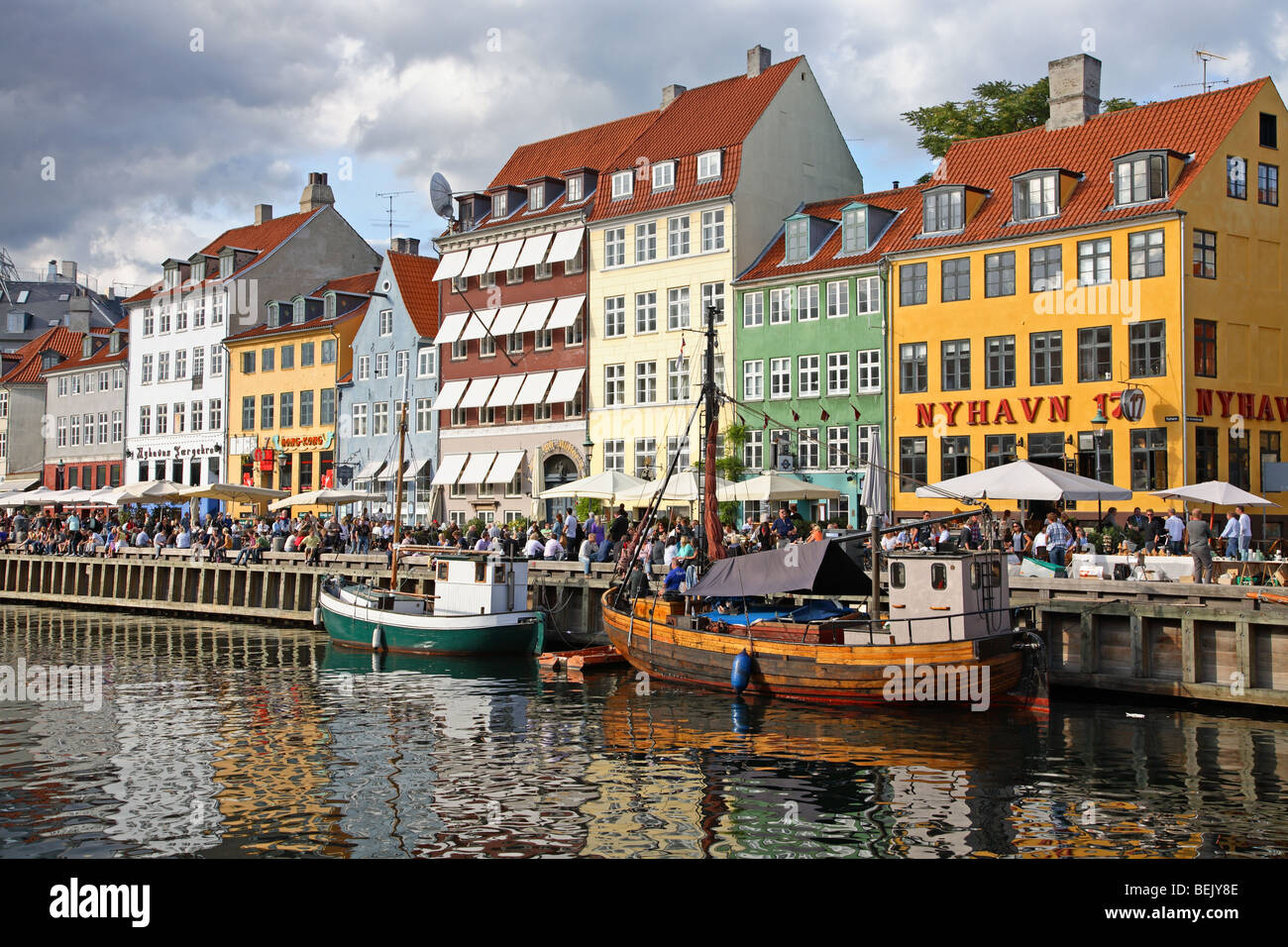 The canal in Nyhavn, Copenhagen, the old harbour quarter famous for  the old  painted houses, restaurants, bars, - Stock Image