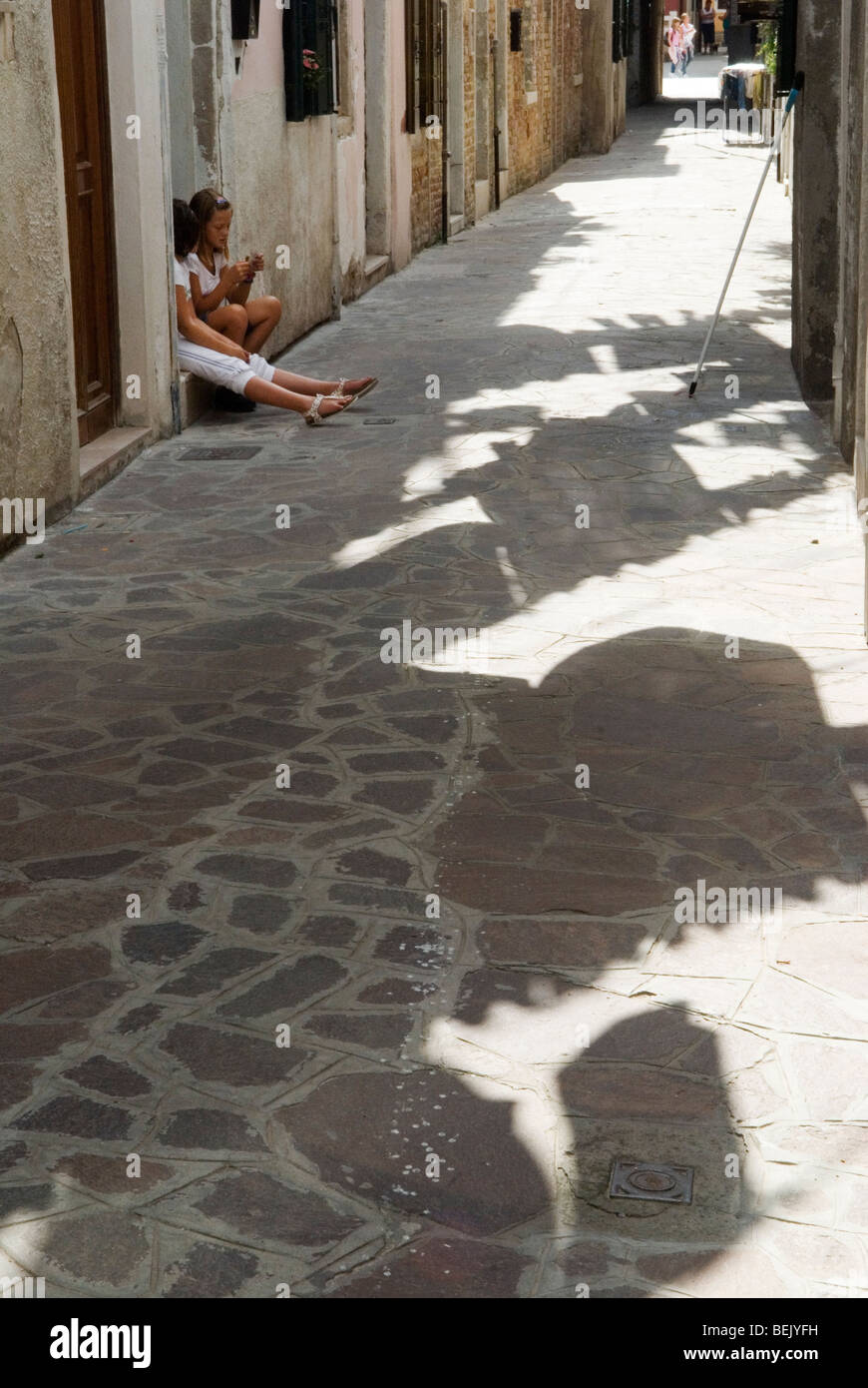 Venice Italy. Children in street between public housing washing hanging out to dry Arsenale Venice. HOMER SYKES - Stock Image