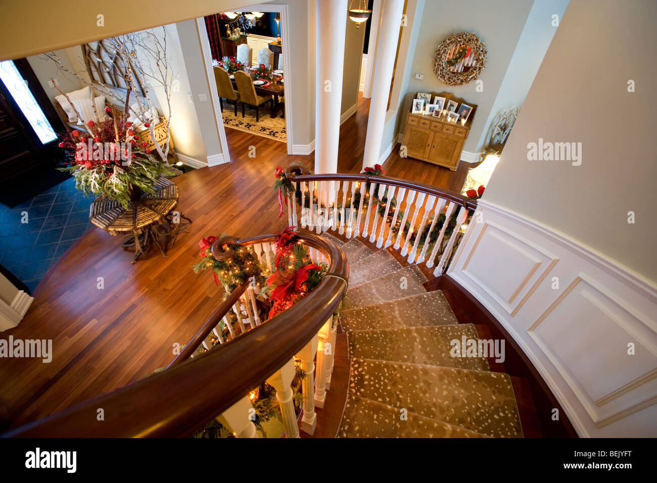 Elegant Curved Staircase With Christmas Decorations Stock Photo Alamy