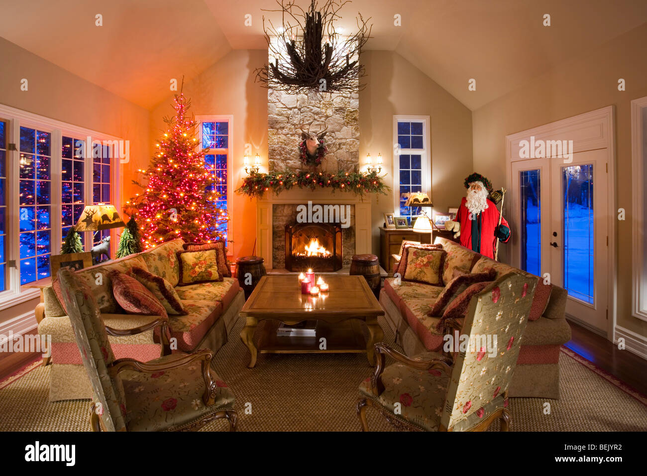 Family Room With Stone Fireplace And Christmas Tree Stock Photo
