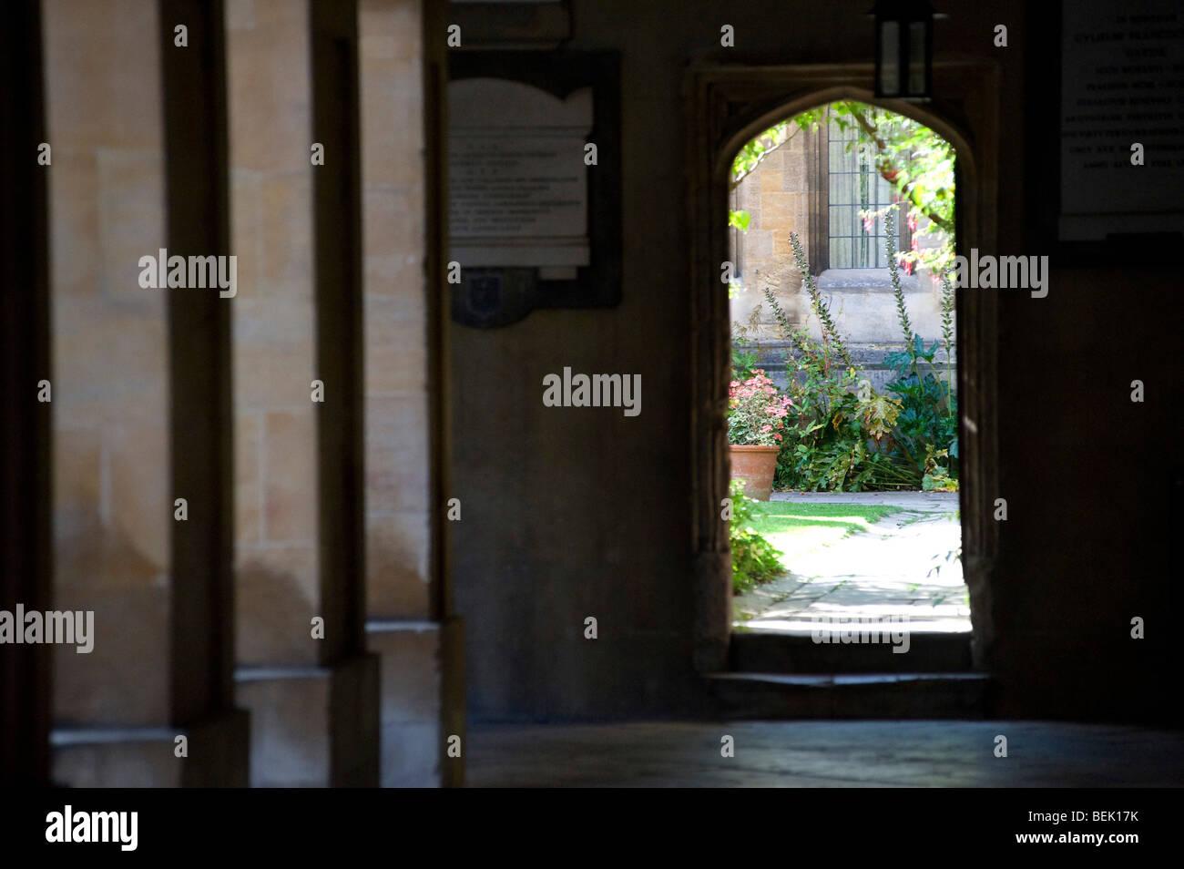 Corpus Christi College Oxford University, through cloisters to the gardern - Stock Image