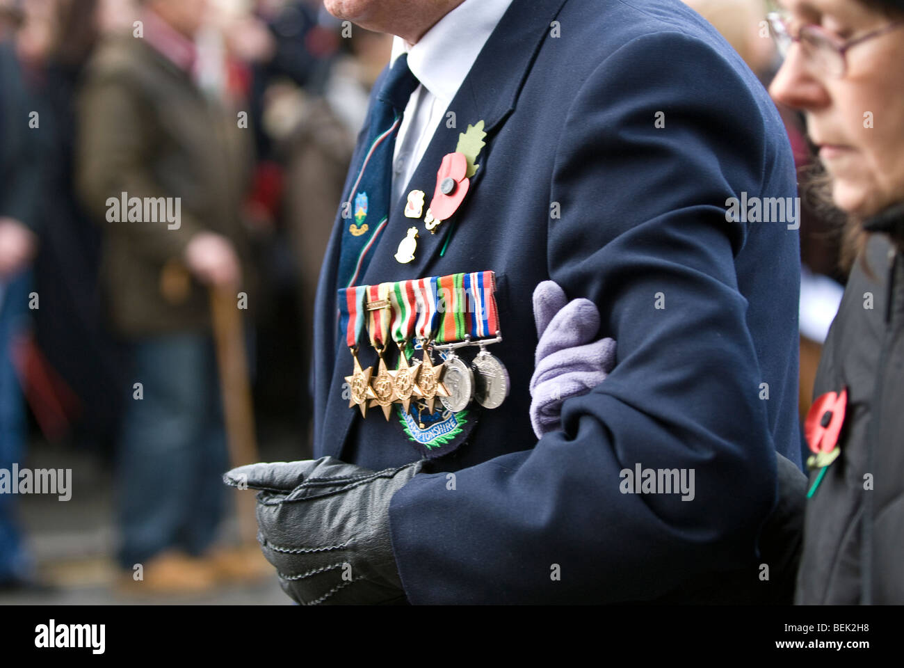 Veteran soldier parades proudly wearing medals presented for armed service duties during conflict & war. Stratford - Stock Image