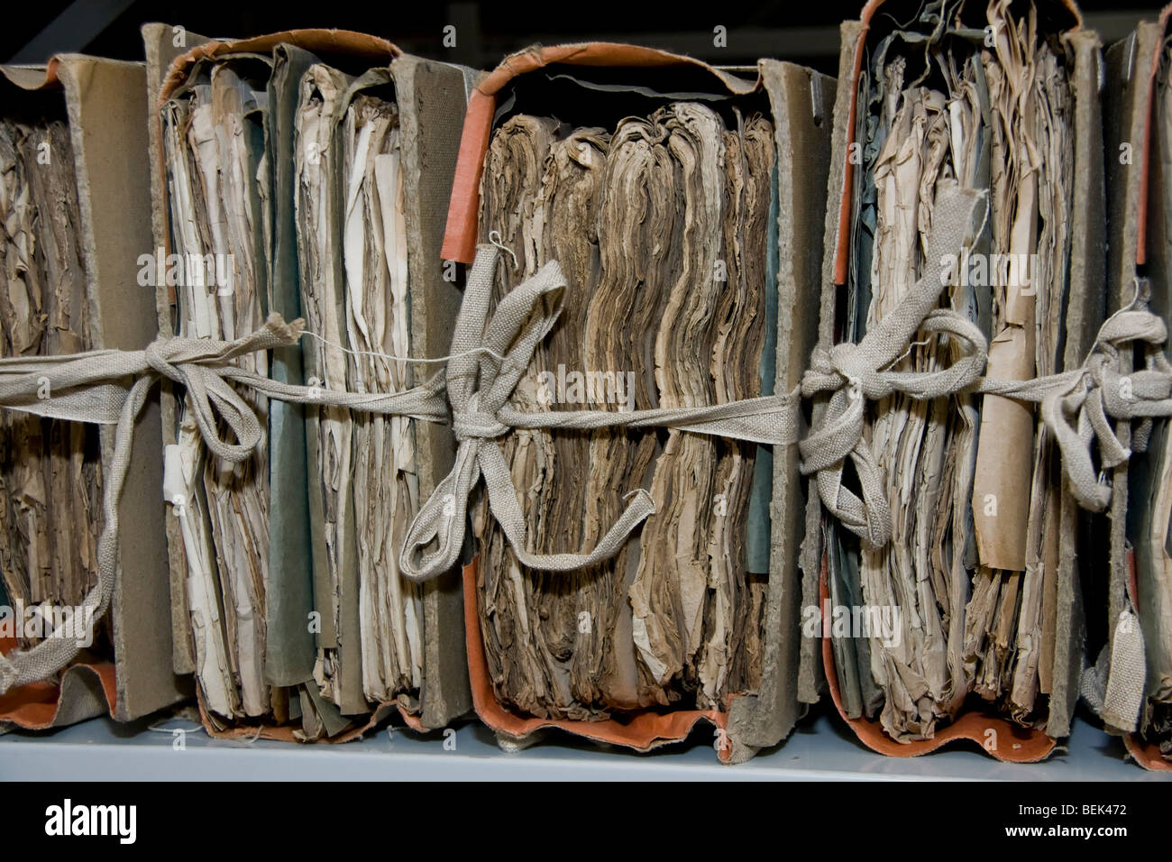 Collection of very old papers stored in folders, bound together - Stock Image