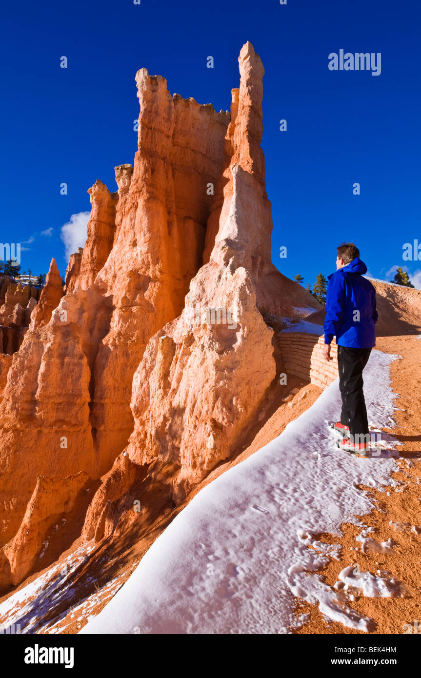 Rock formations and hiker on the Queens Garden Trail, Bryce Canyon National Park, Utah - Stock Image